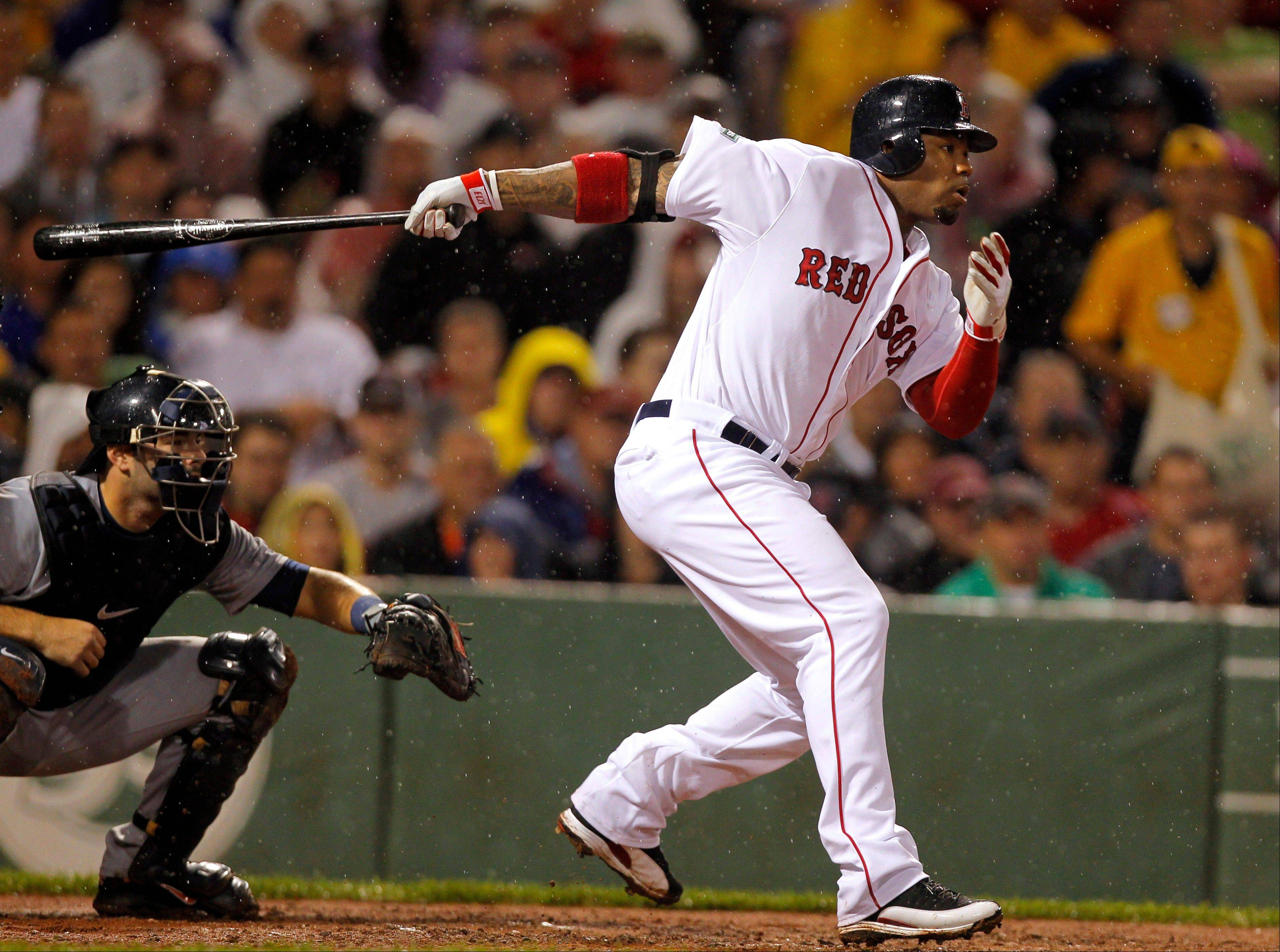 Boston�s Carl Crawford hits an RBI single off Detroit�s Justin Verlander in the fourth inning Tuesday at Fenway Park.