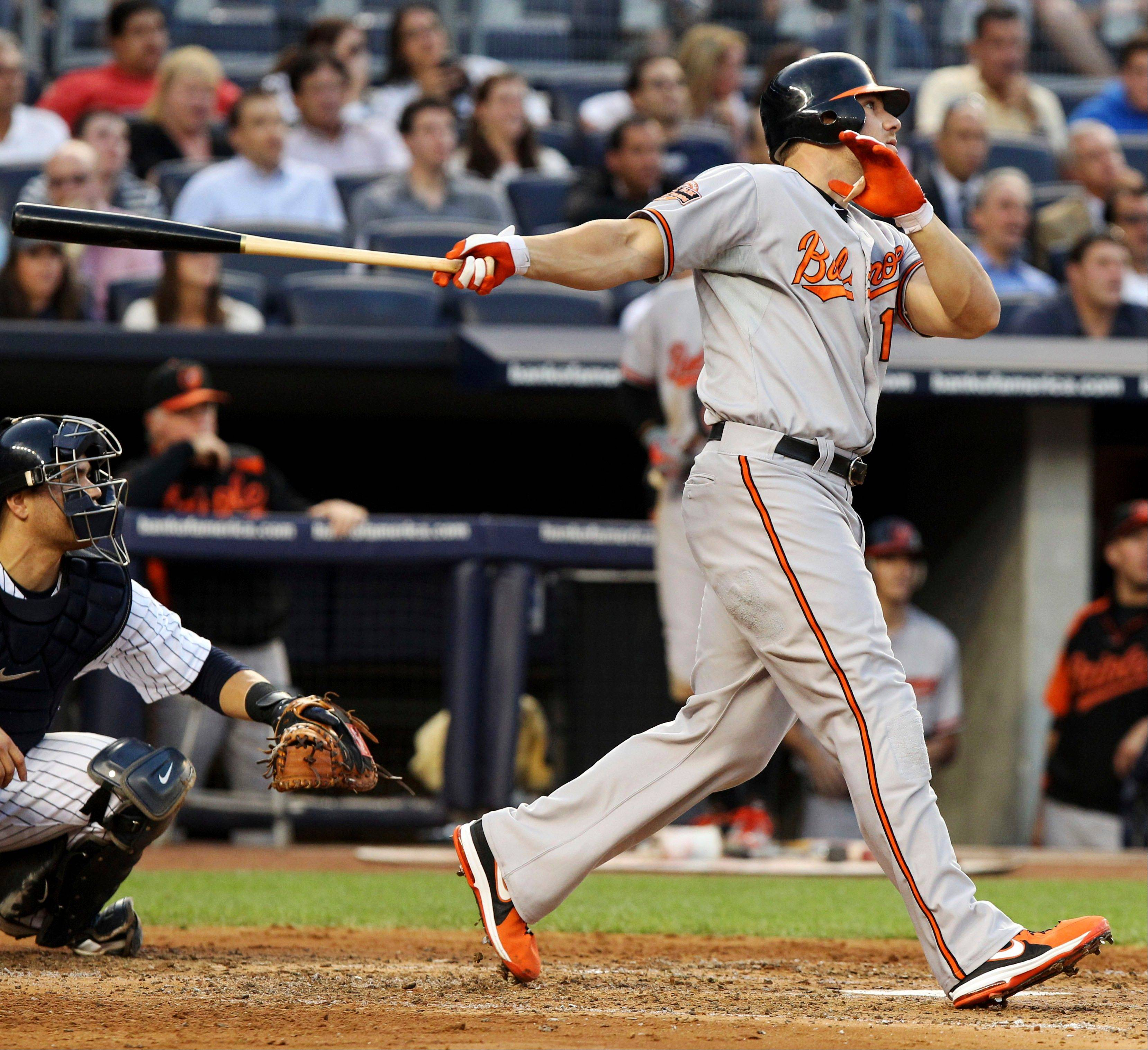 Baltimore�s Chris Davis hits a grand slam during the second inning Tuesday in New York.
