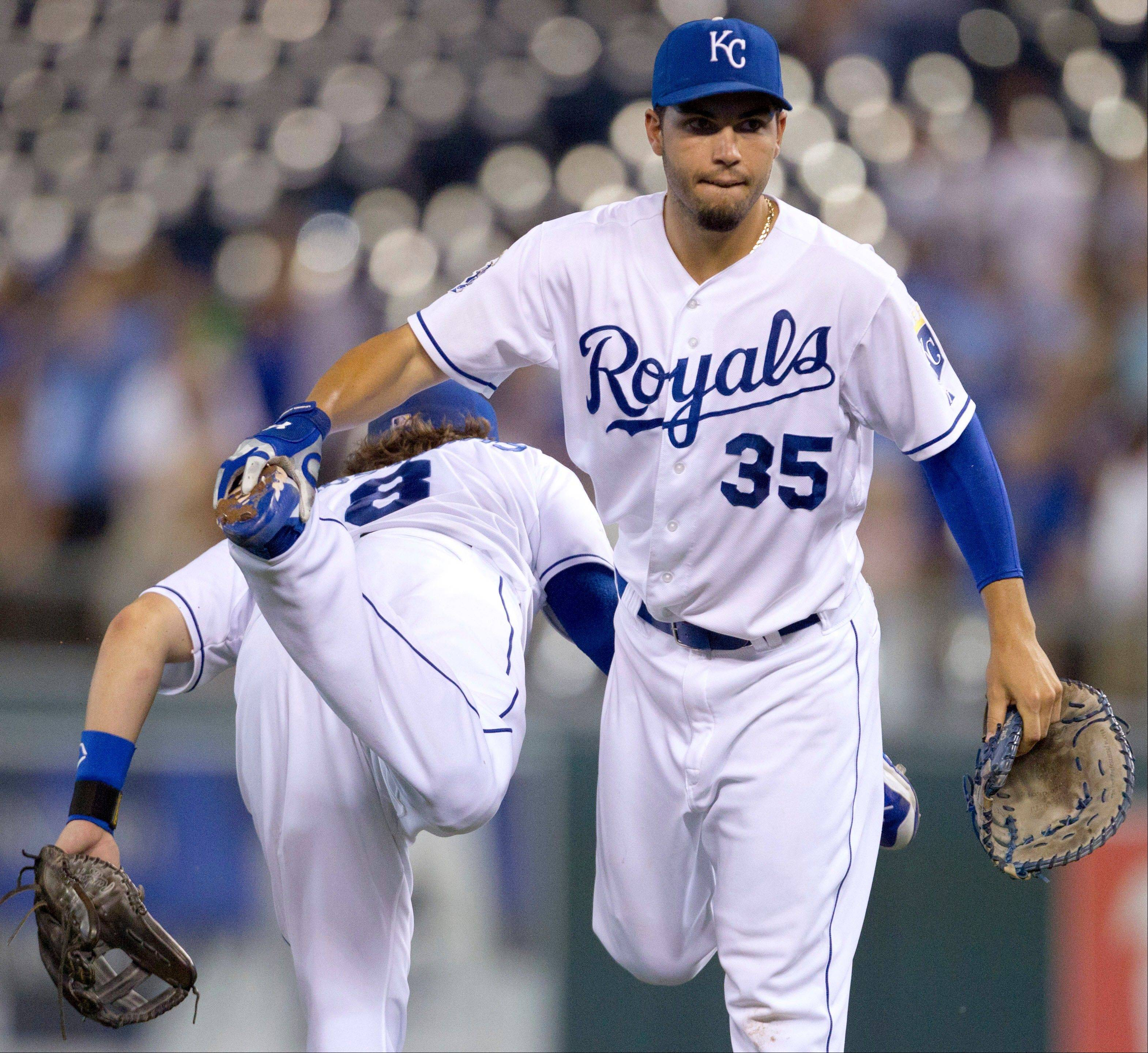 Royals third baseman Mike Moustakas and first baseman Eric Hosmer celebrate Tuesday�s home win against the Cleveland Indians.