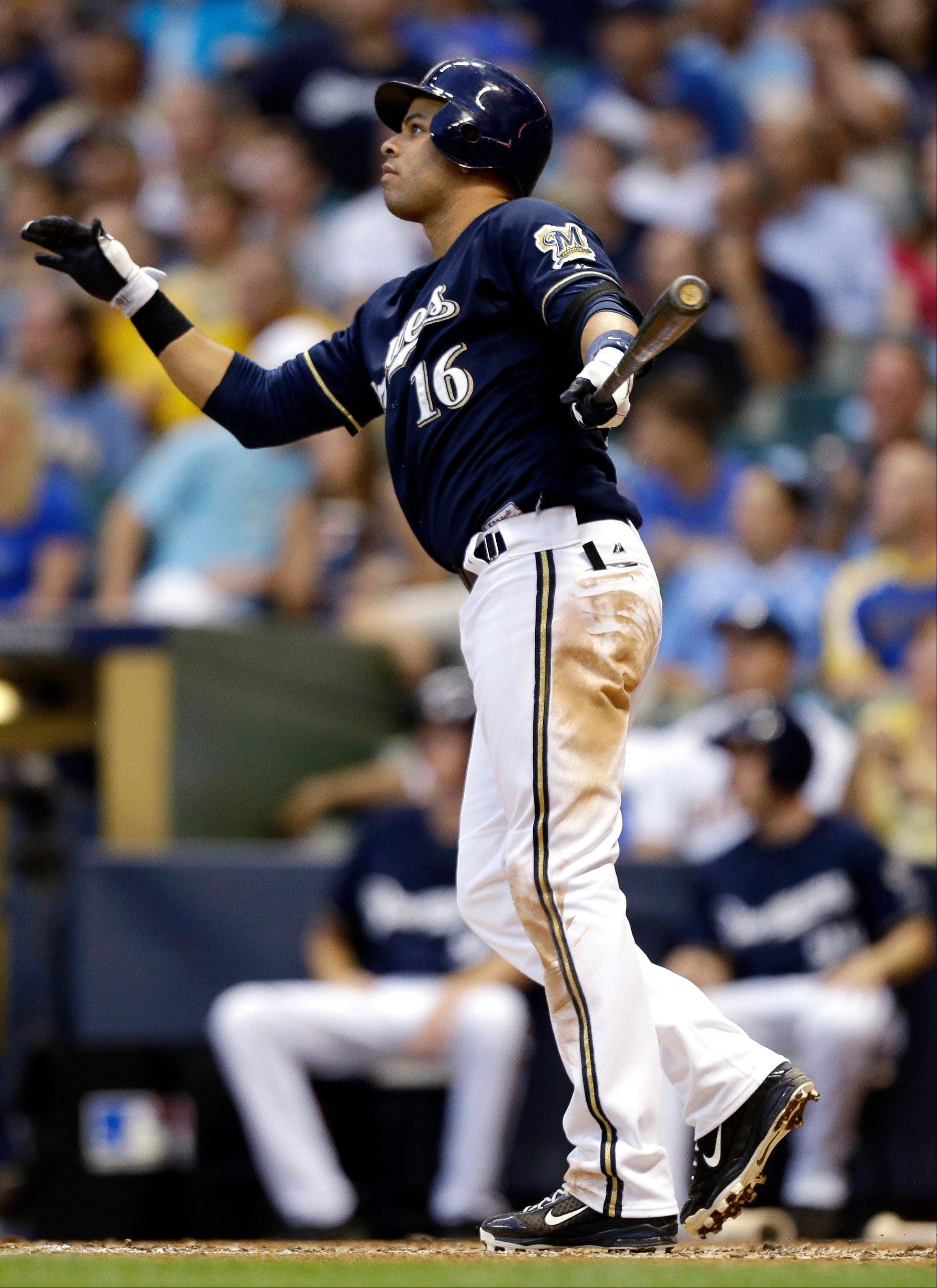 The Brewers� Aramis Ramirez watches his three-run home run leave the park against the Houston Astros during the third inning Tuesday in Milwaukee.