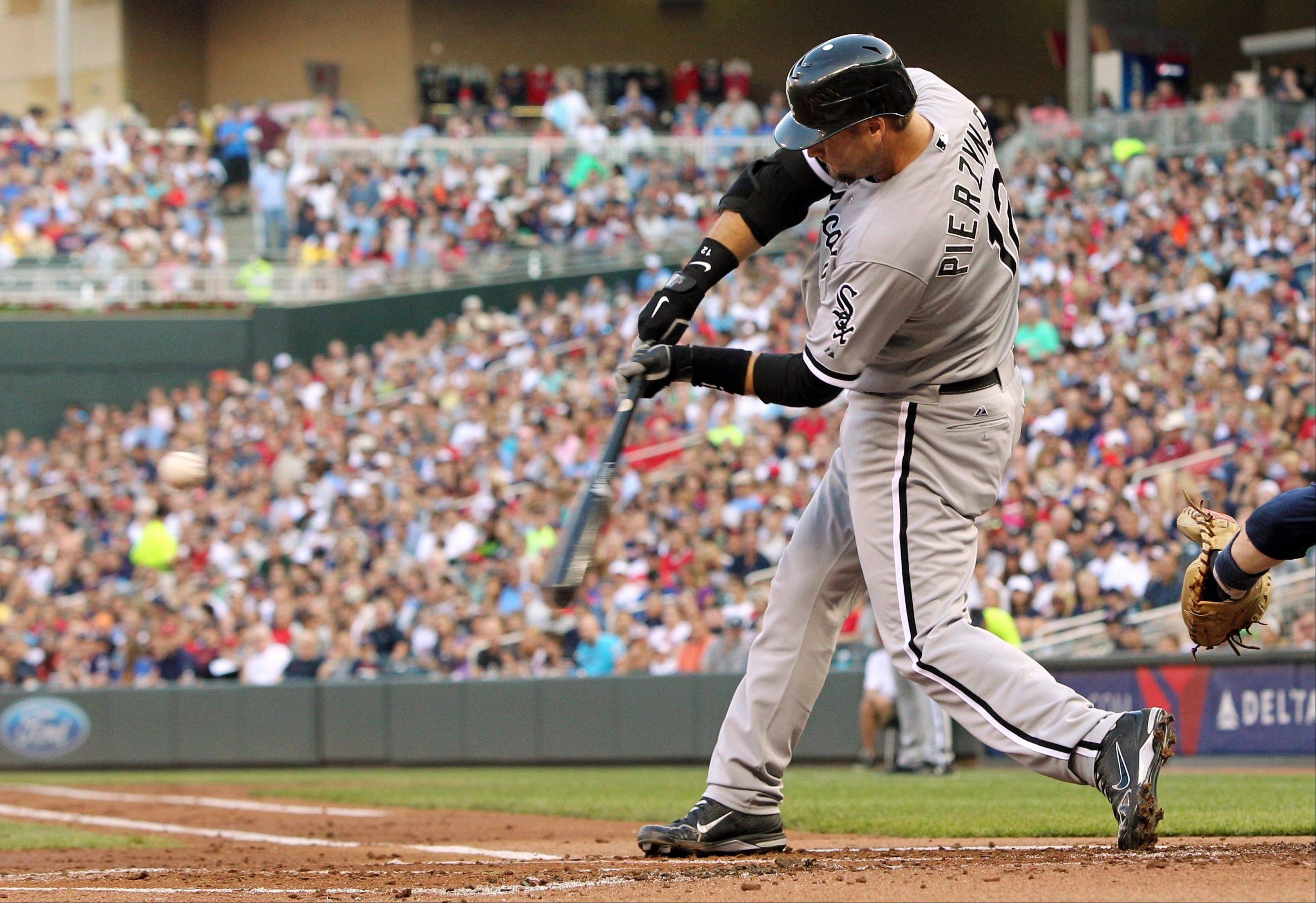 White Sox catcher A.J. Pierzynski hits a single against Minnesota Twins starting pitcher Nick Blackburn Tuesday during the second inning.