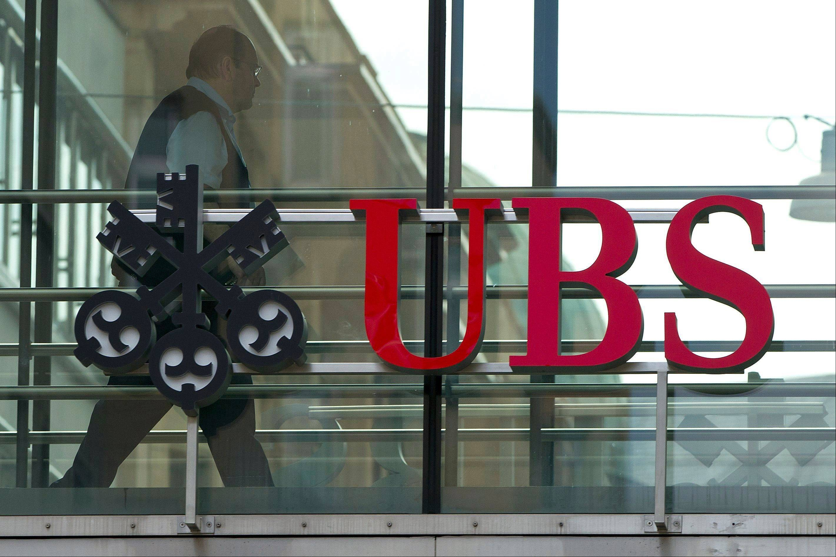 "UBS AG posted second-quarter net profits of 425 million Swiss francs (US$434.16 million) Tuesday, July 31, 2012, a sharp plunge from the 1.02 billion Swiss francs (US$1.2 billion) it posted in the comparable period a year ago. Hit by lower trading revenue and fewer commissions and client fees, Switzerland's largest bank said the 58 percent net profit drop reflects ""challenging conditions marked by increased volatility and greater client caution."""