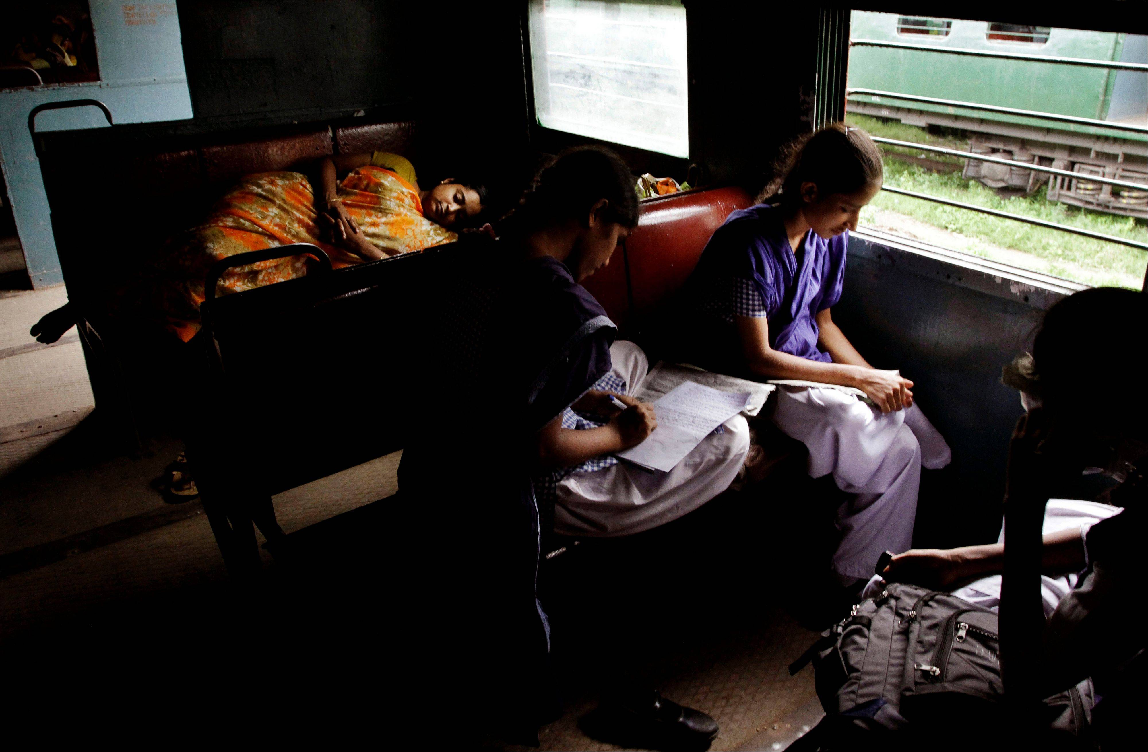 Indian stranded passengers wait inside a stalled local train following a power outage in Kolkata, India, Tuesday, July 31, 2012. India's energy crisis cascaded over half the country Tuesday when three of its regional grids collapsed, leaving 620 million people without government-supplied electricity for several hours in, by far, the world's biggest-ever blackout.