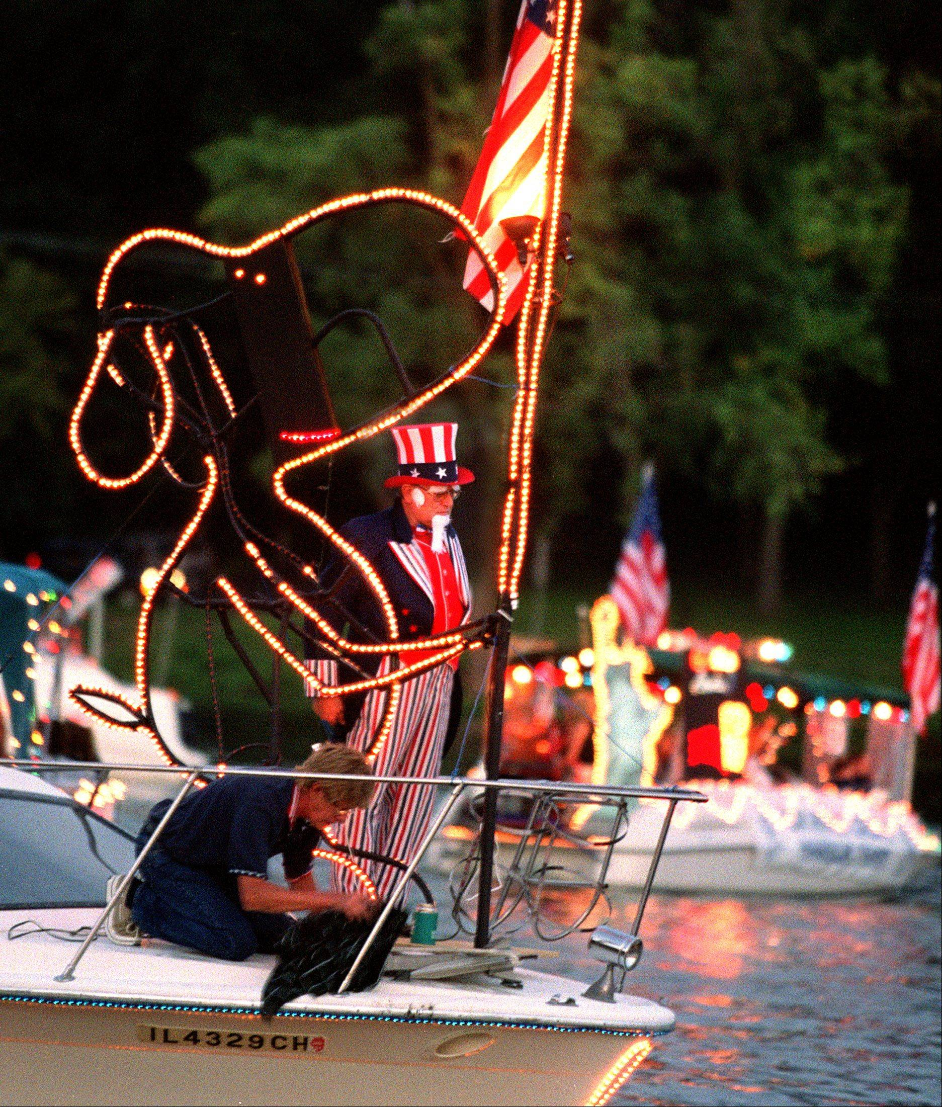 A boat sported Uncle Sam and Snoopy imagery at a previous year's Fox Lake Venetian Night.