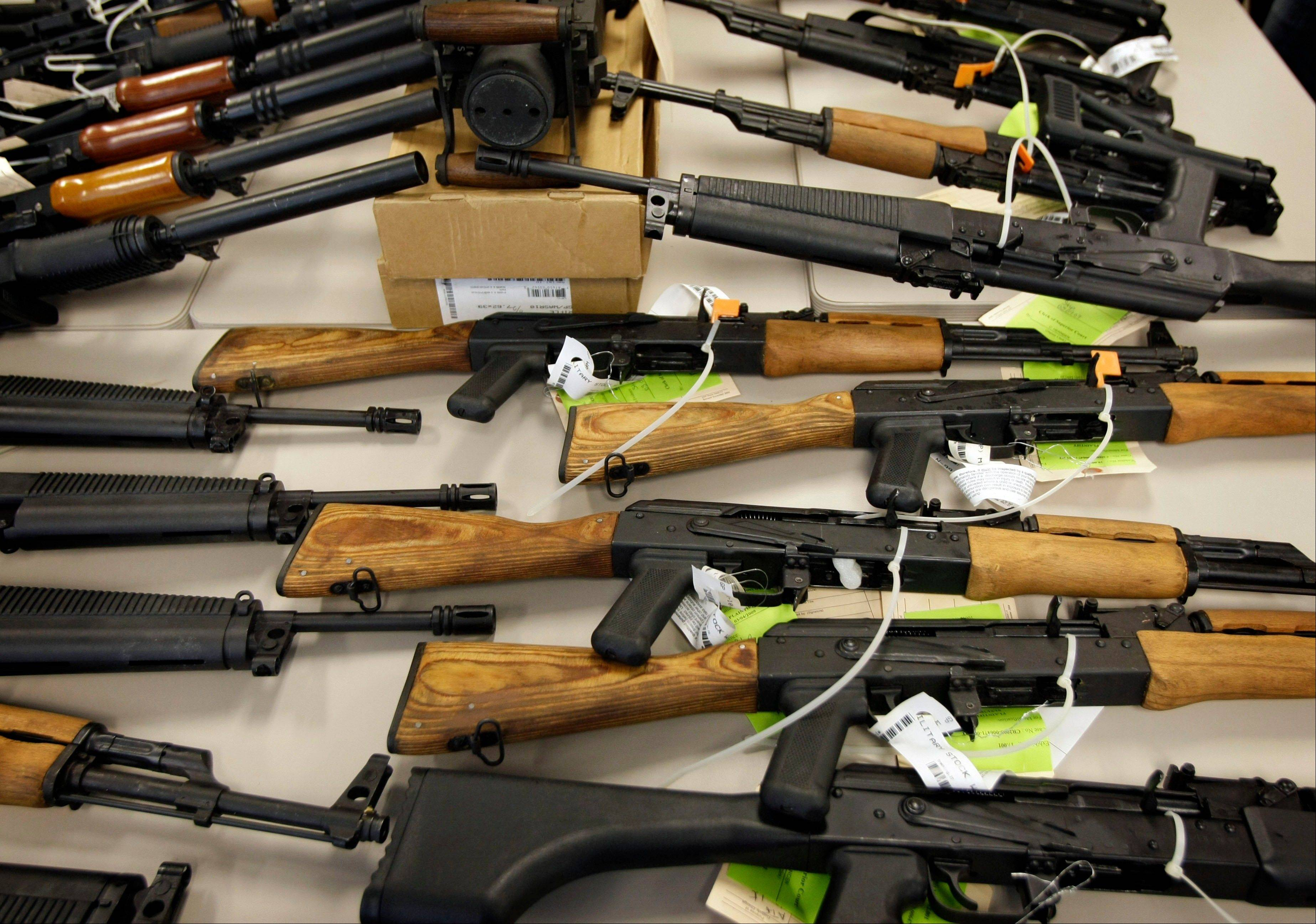 "This photo from Jan. 25, 2011, shows part of a cache of seized weapons displayed at a news conference in Phoenix that was part of a Phoenix-based gun-trafficking investigation called ""Fast and Furious,"" in which agents allowed hundreds of guns into the hands of straw purchasers in hopes of making a bigger case."