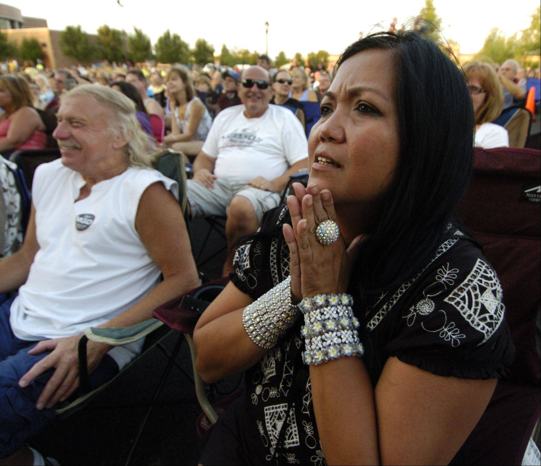 "Gigi Jardine of Norridge watches as Dennis DeYoung: ""The Music of Styx"" performs during the Elk Grove Mid Summer Classics concert series on the Village Green Tuesday."