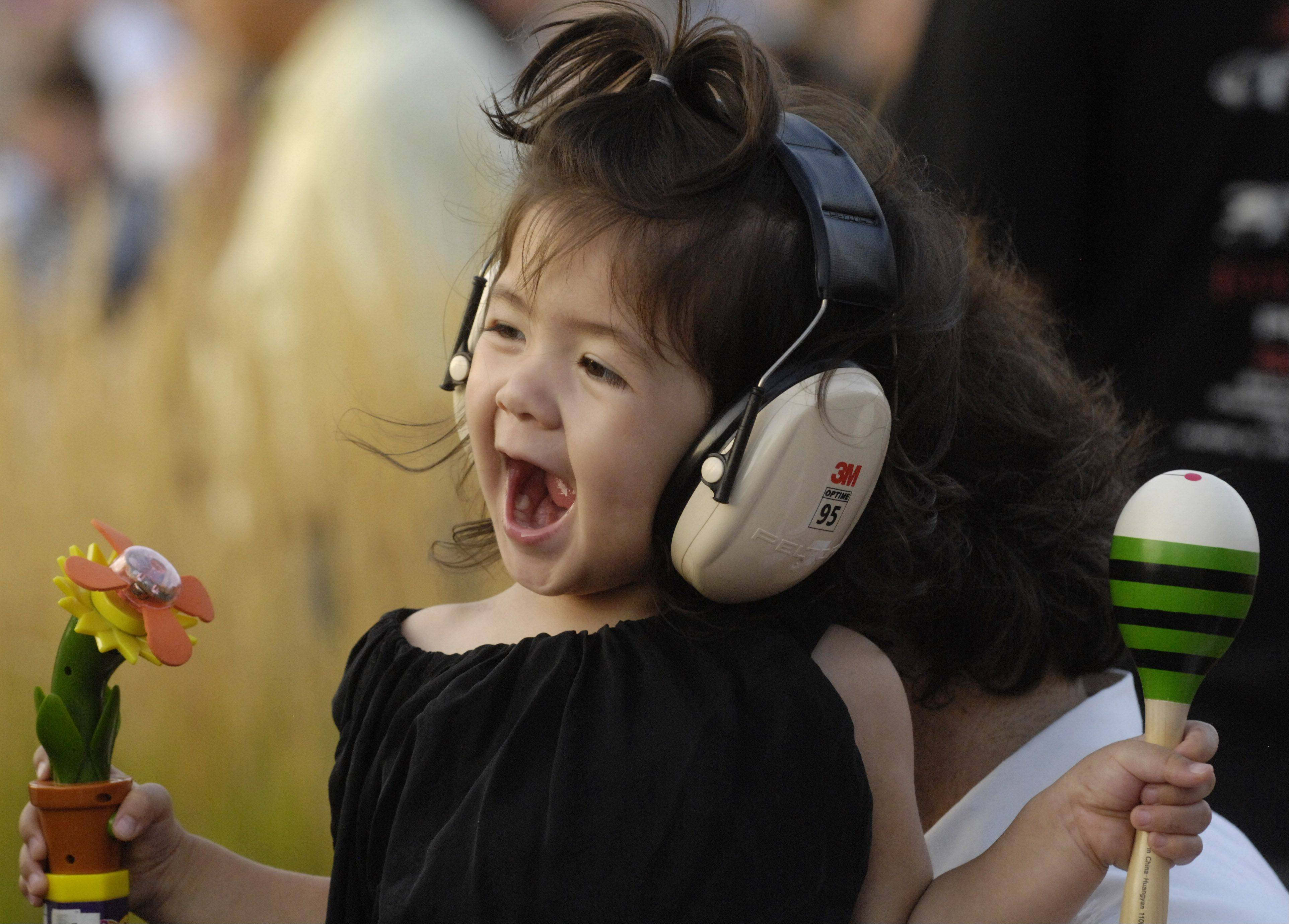 "Zoe Orchard, 2, of Chicago enjoys the show as Dennis DeYoung: ""The Music of Styx"" performs during the Elk Grove Mid Summer Classics concert series on the Village Green Tuesday."