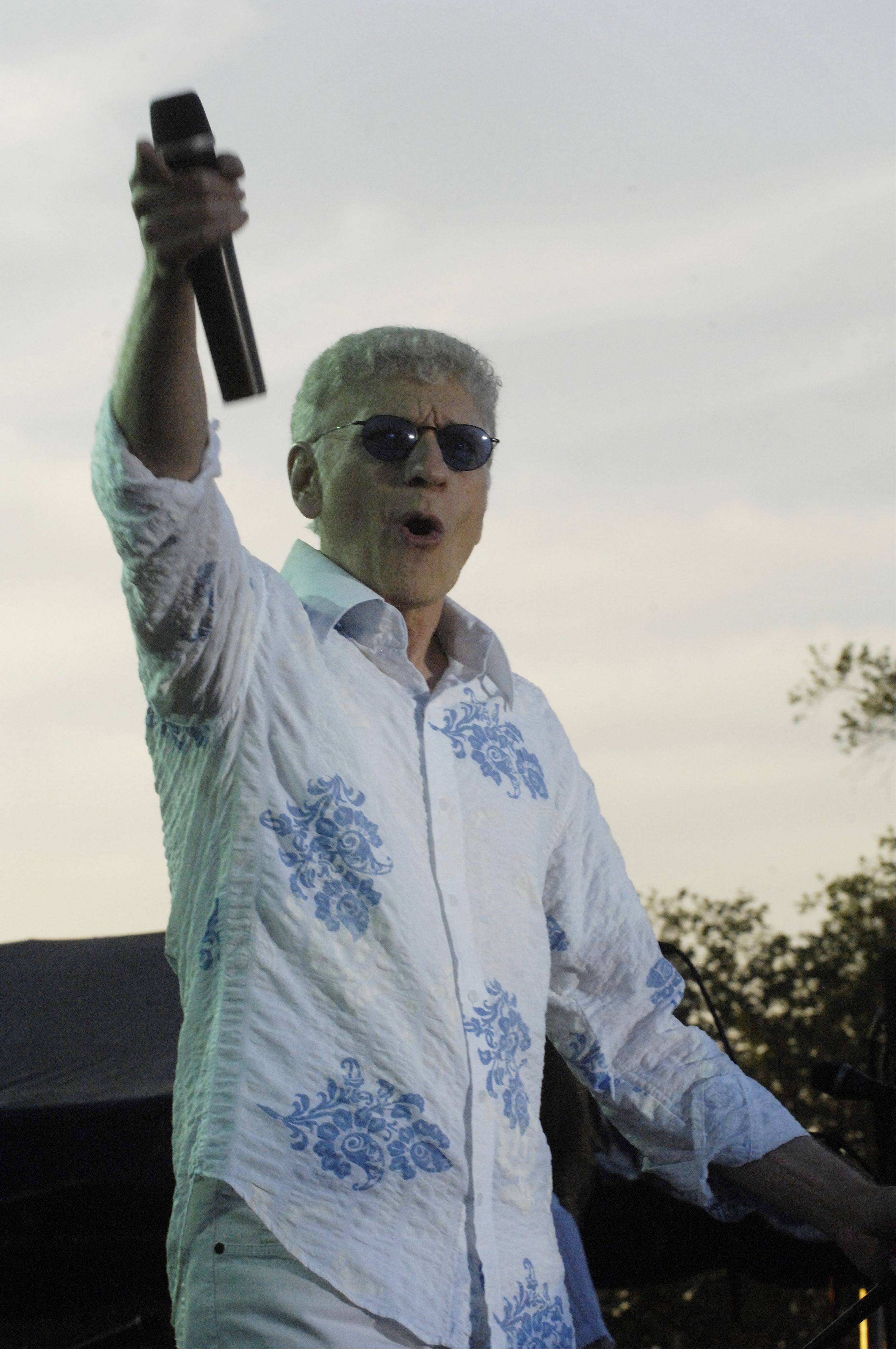 Dennis DeYoung greets the audience at Tuesday night's concert in Elk Grove Village.