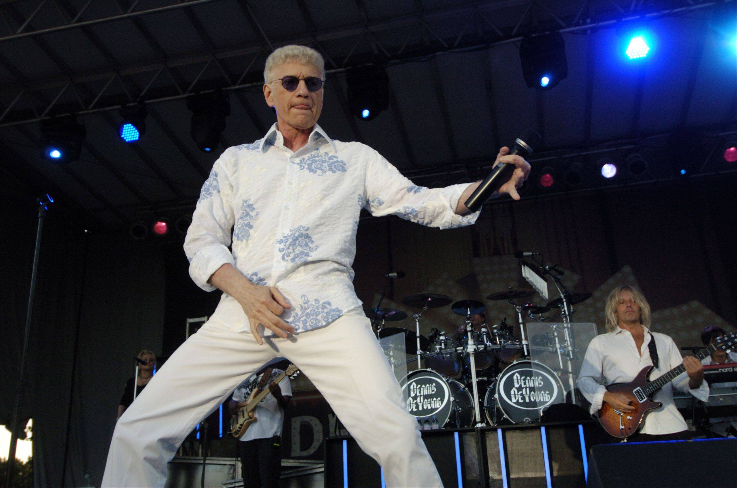 "Dennis DeYoung plays ""air guitar"" during Tuesday night's concert in Elk Grove Village."