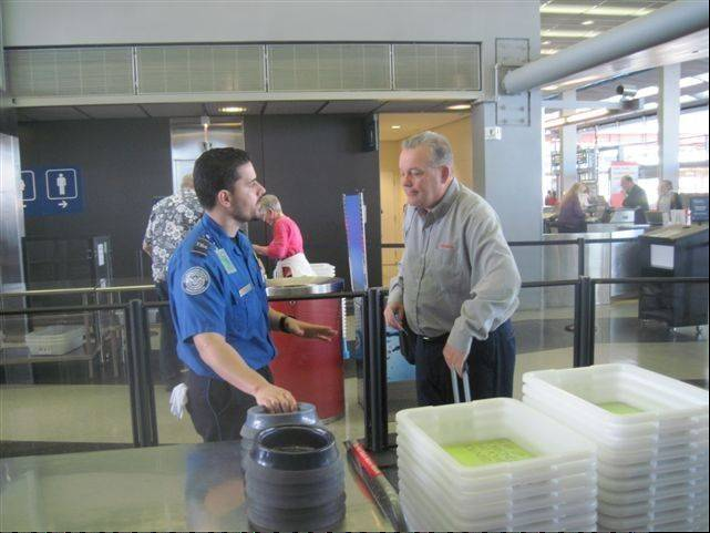 An American Airlines passenger uses the TSA's Pre-Check screening station at O'Hare's Terminal 3 in March.