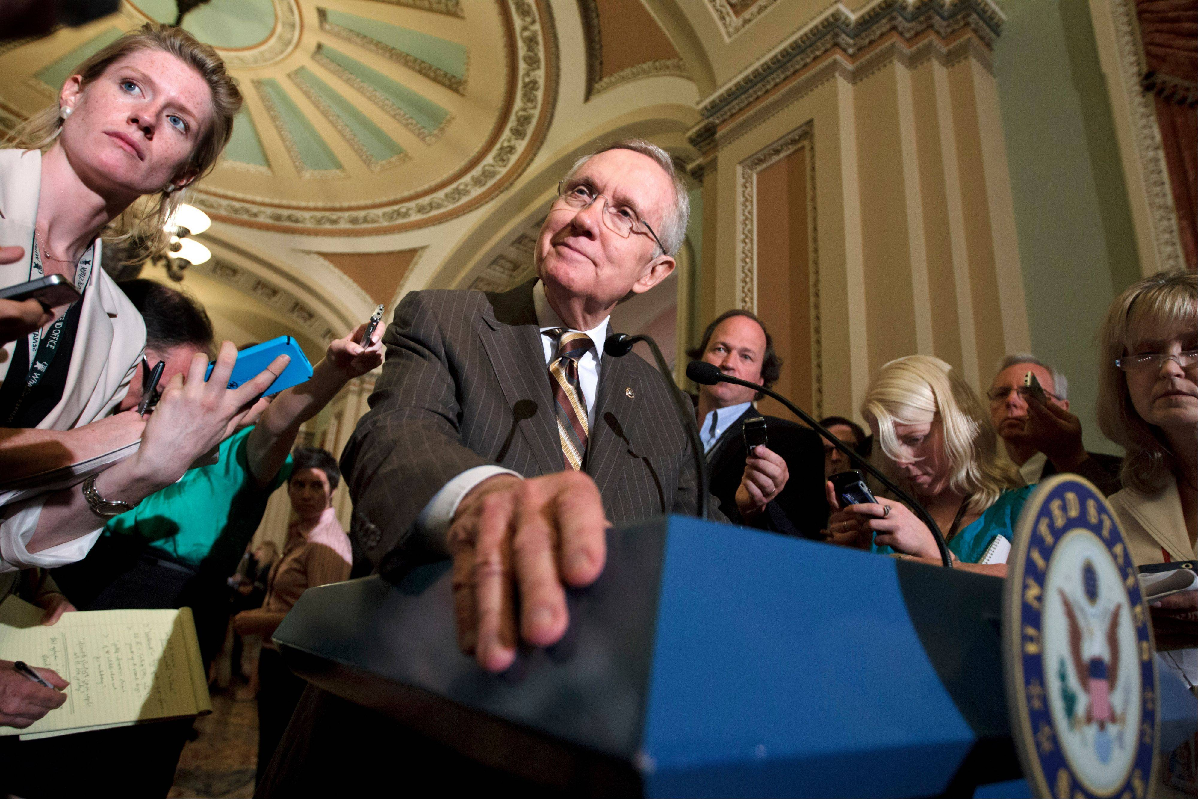 Senate Majority Leader Harry Reid announces to reporters on Capitol Hill Tuesday that he and GOP House Speaker John Boehner have reached an agreement to keep the government running on autopilot for six months when the current budget year ends Sept. 30.
