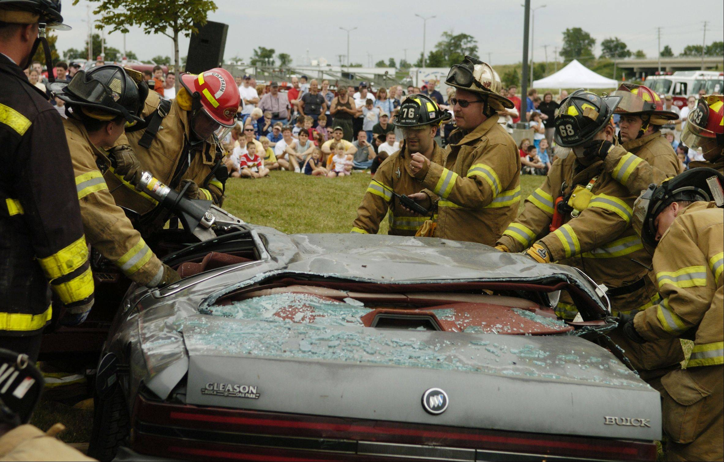 During a demonstration at last year's North Aurora Days' Emergency Vehicle Show, North Aurora firefighters work to extricate the driver of a vehicle that was smashed by a truck.