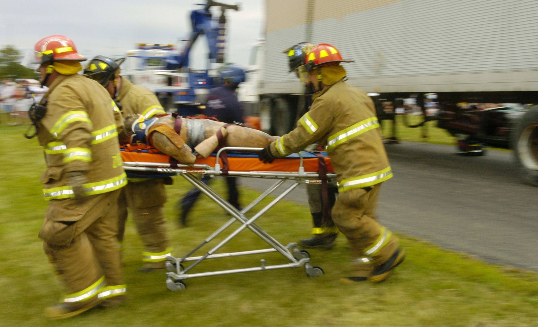 North Aurora firefighters quickly wheel a mannequin to a waiting helicopter during an extrication demonstration during last year's Emergency Vehicle Show.