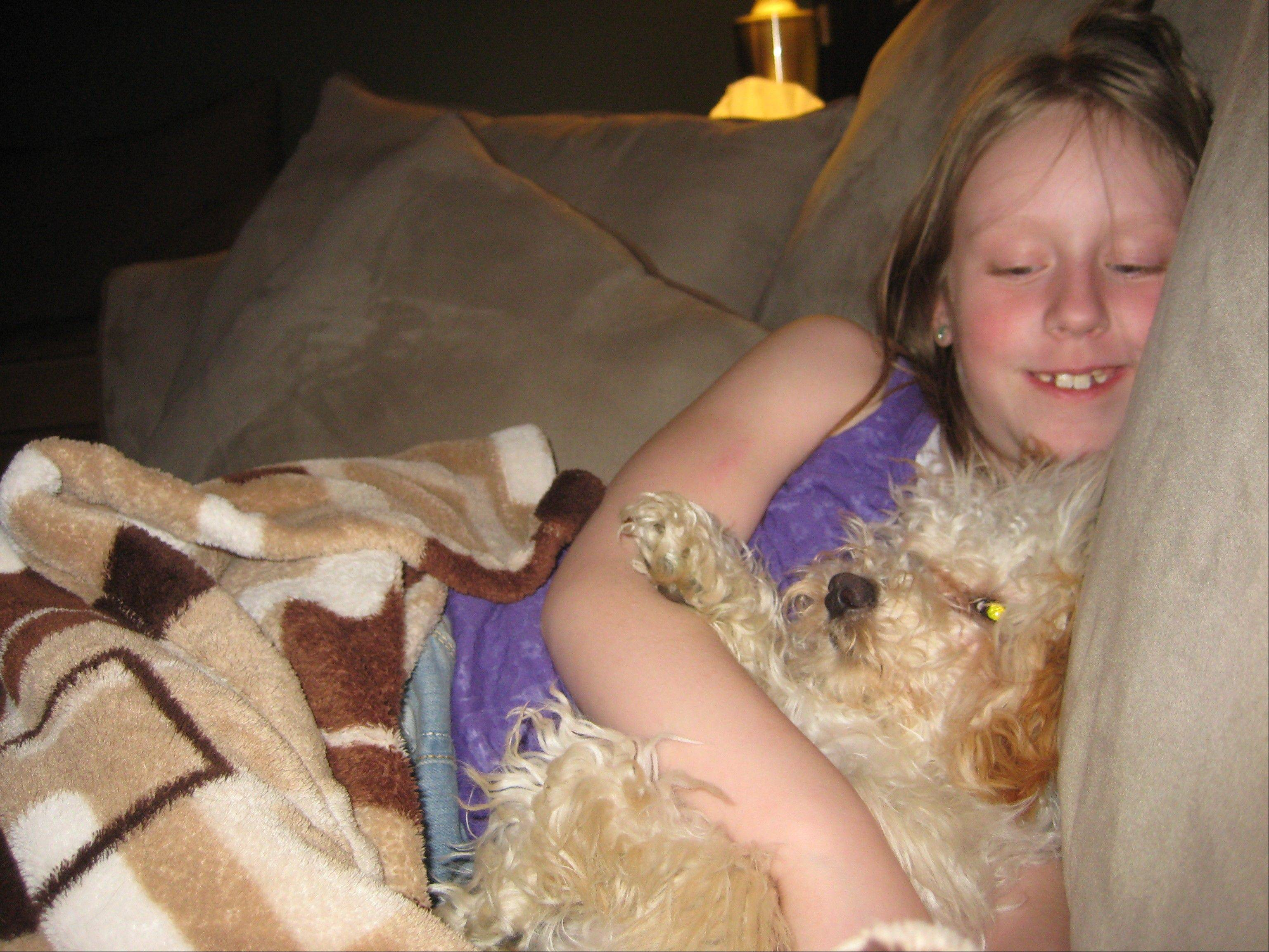 Delaney Ketter, 11, was with her family's dog, Daisy, when the 3-year-old bichon frise-poodle mix was attacked and killed by a pit bull in Villa Park.