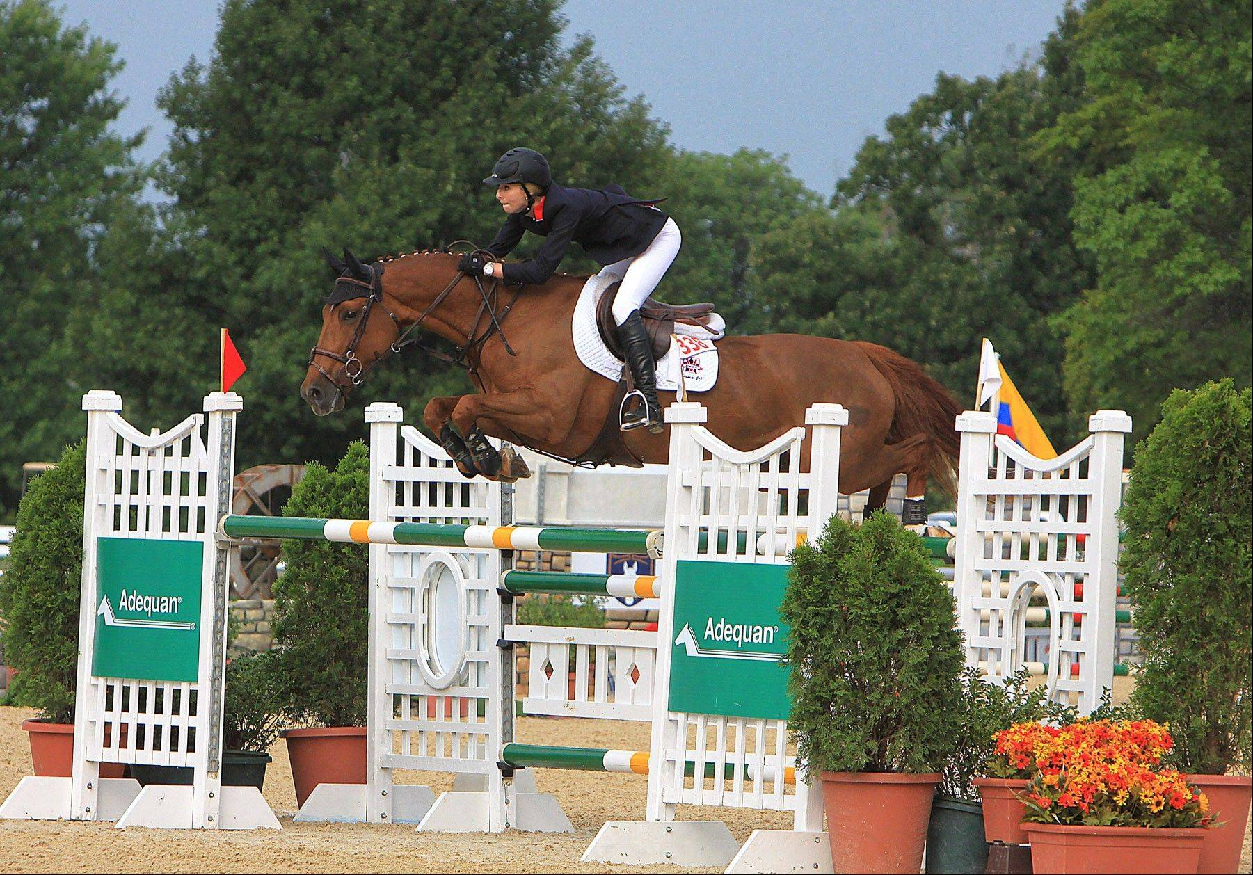 Abigail McArdle and Cosma 20 make a clean jump.
