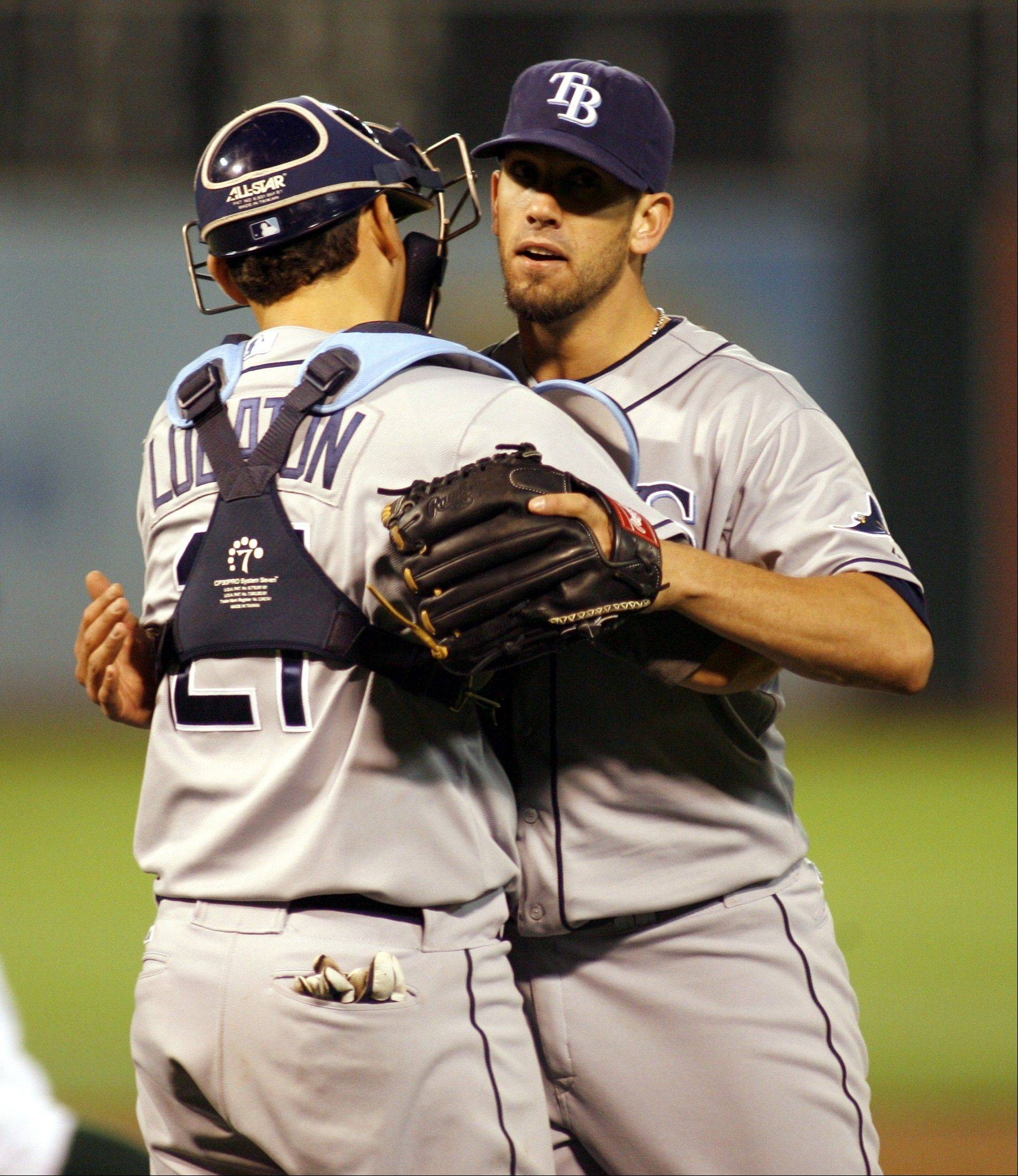 Tampa Bay Rays pitcher James Shields hugs catcher Jose Lobaton after pitching a three-hit shutout Tuesday night in Oakland.