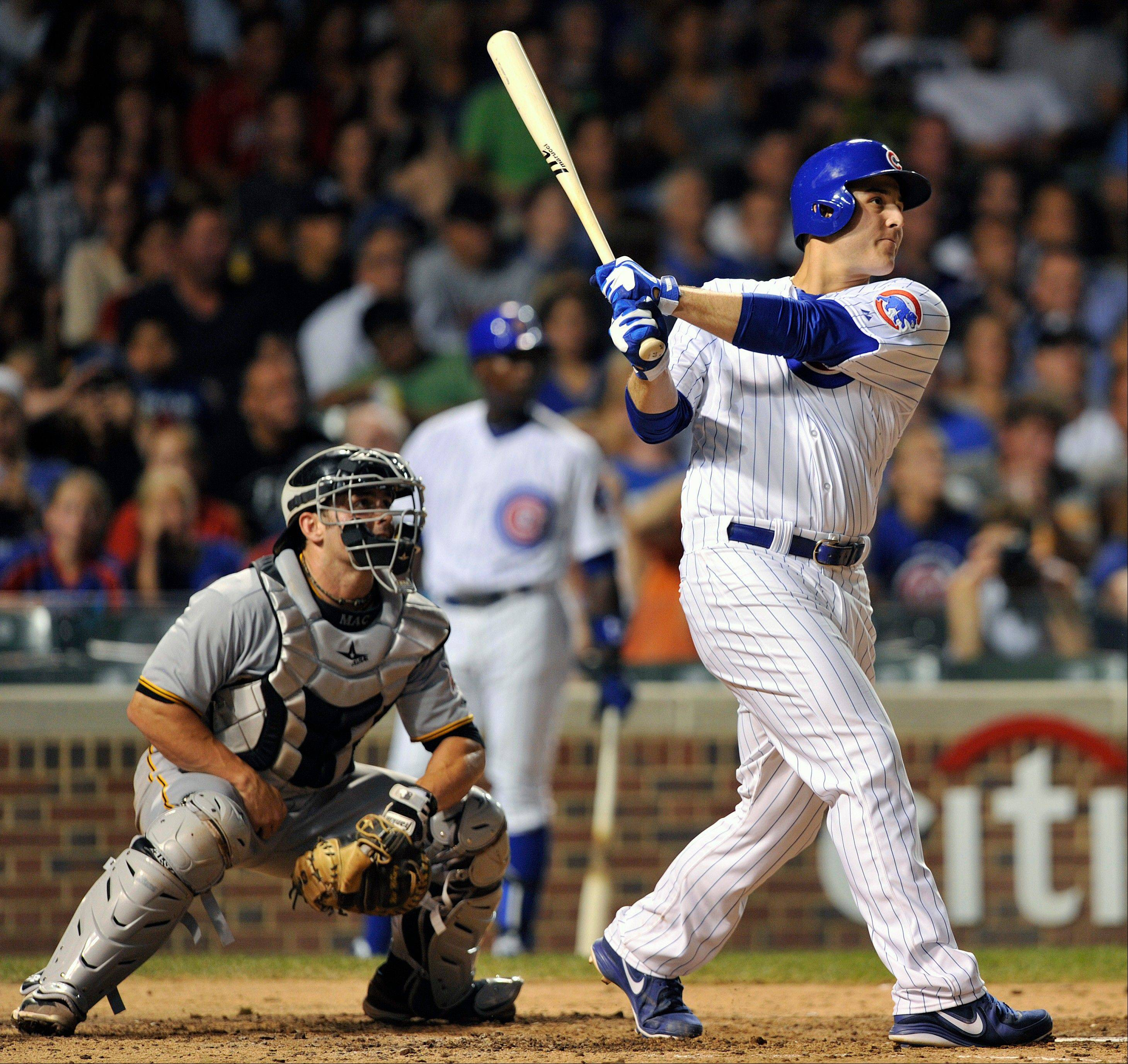 Pittsburgh Pirates catcher Michael McKenry watches as Anthony Rizzo follows through on a 3-run home run during the Cubs' victory Monday night.