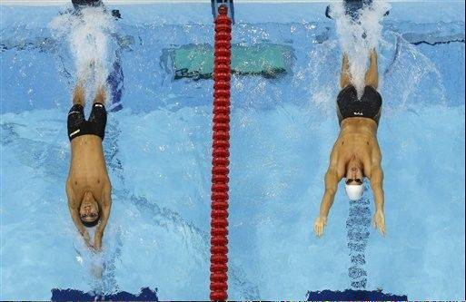 Japan's Ryosuke Irie, left, and United States' Matthew Grevers start in a men's 100-meter backstroke swimming heat Sunday at the Aquatics Centre in the Olympic Park during the 2012 Summer Olympics in London.