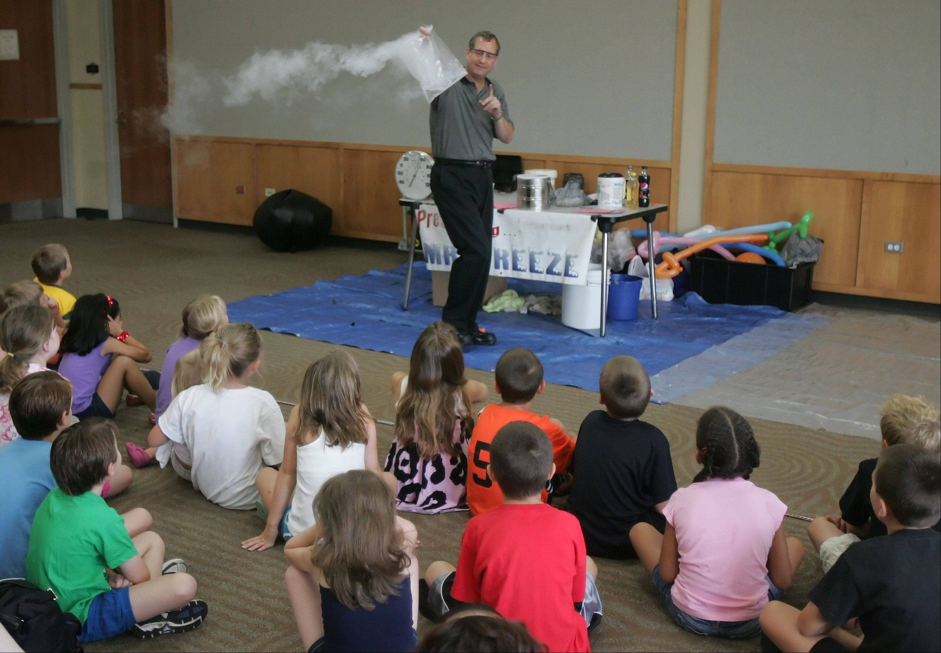 Jerry Zimmerman, also known as Mr. Freeze of Fermilab, demonstrates fun properties of cryogenics for children at Ela Area Public Library. Zimmerman discussed the properties of liquid nitrogen and its affects on air, liquids and solids.
