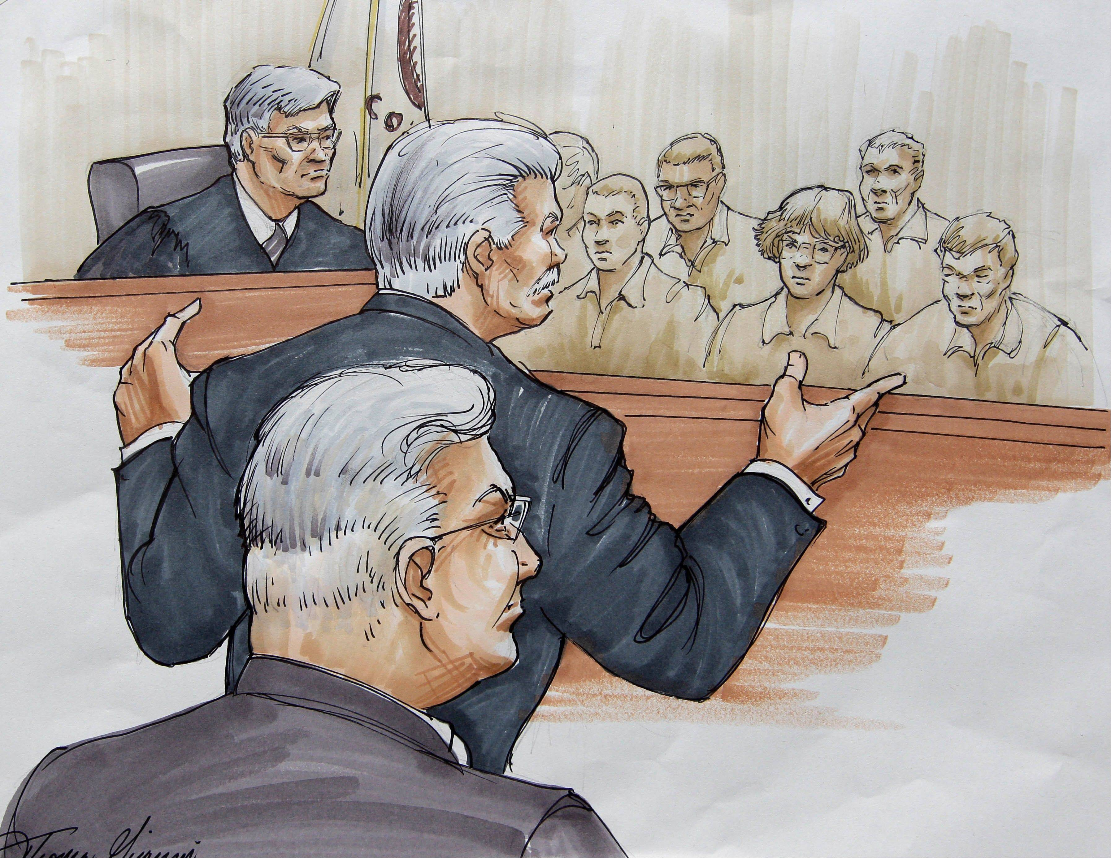 In this courtroom sketch, Drew Peterson, foreground, looks on, as Will County State's Attorney James Glasgow gives his opening statement before Judge Edward Burmila and jurors Tuesday in Joliet in Peterson's murder trial. Peterson is charged in the 2004 death of his third wife Kathleen Savio.