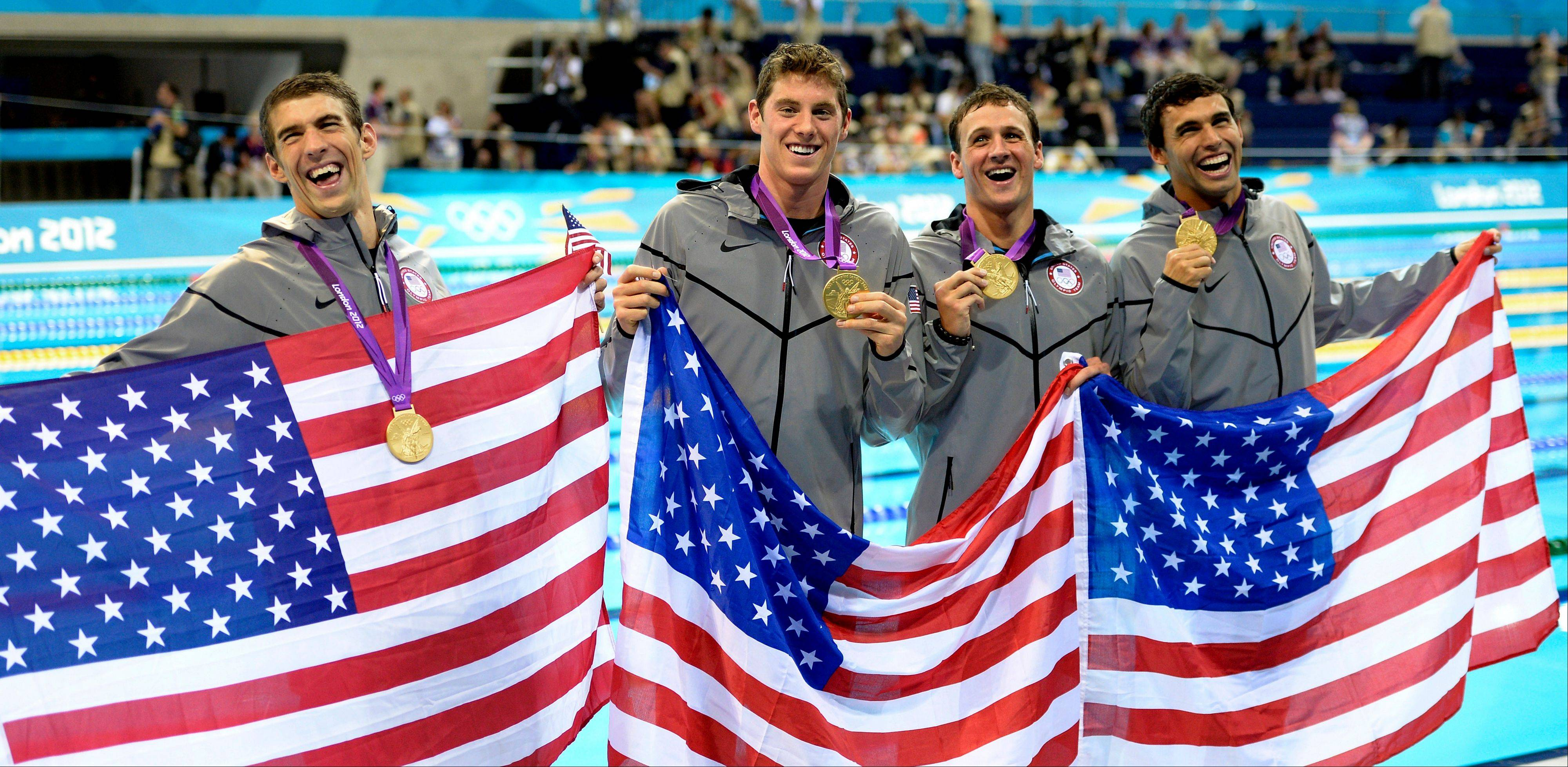 From left, Michael Phelps, Conor Dwyer of Winnetka, Ricky Berens and Ryan Lochte celebrate their gold medal Tuesday in the 4x200-meter freestyle relay swimming final.