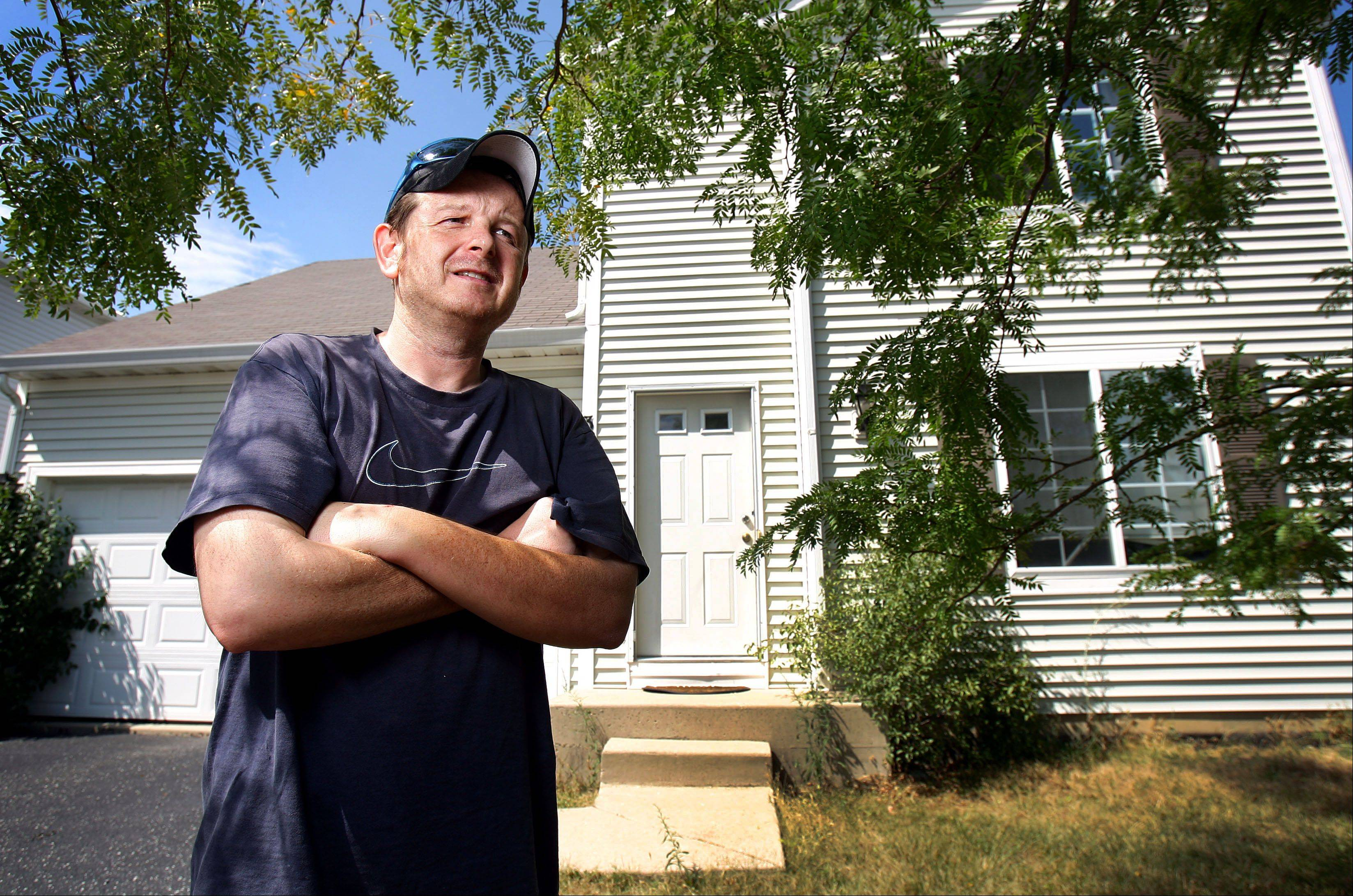 Round Lake Beach homeowner Derek Monroe filed an appeal of his property tax assessment in May and was told it could take more than two years for a decision and a couple months to determine if his paperwork was even received.