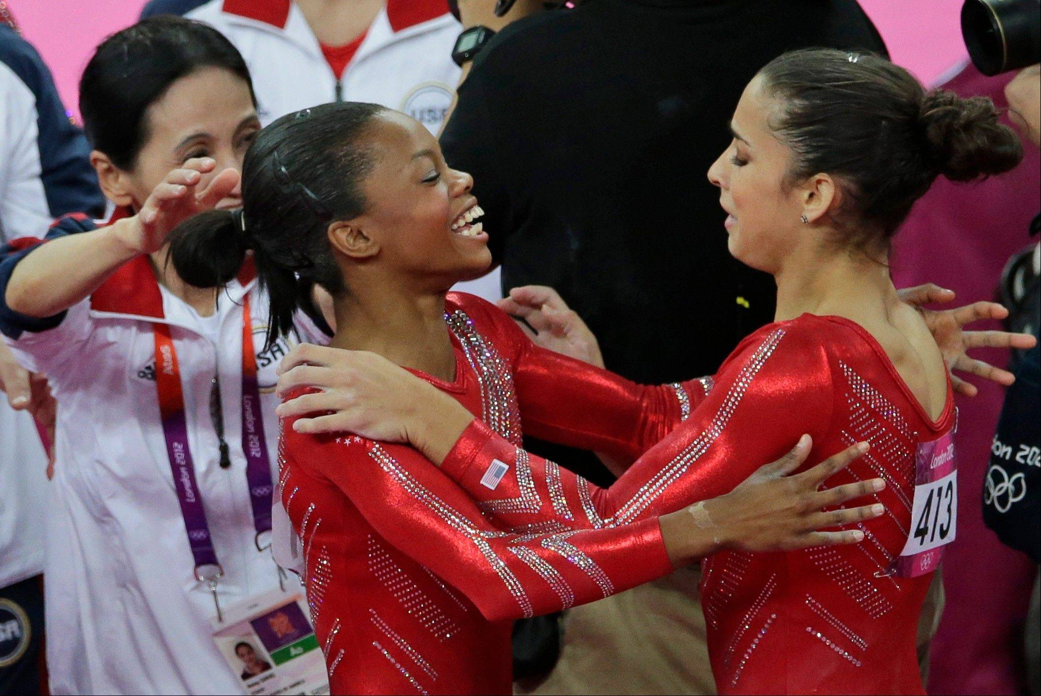 American gymnast Gabby Douglas hugs teammate Aly Raisman during the women's team final on Tuesday at the Summer Olympics. On Thursday, both will compete in the all-around final.