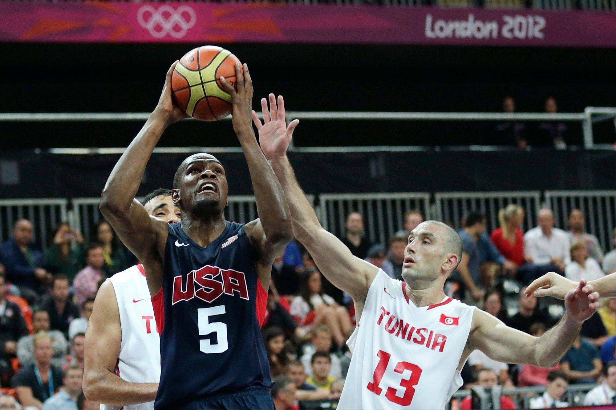 Team USA's Kevin Durant, left, drives to the basket against Tunisia's Amine Rzig during Tuesday's game in the London Olympics. Thursday's game against Nigeria is the second straight, and perhaps last, lesser opponent for the Americans.