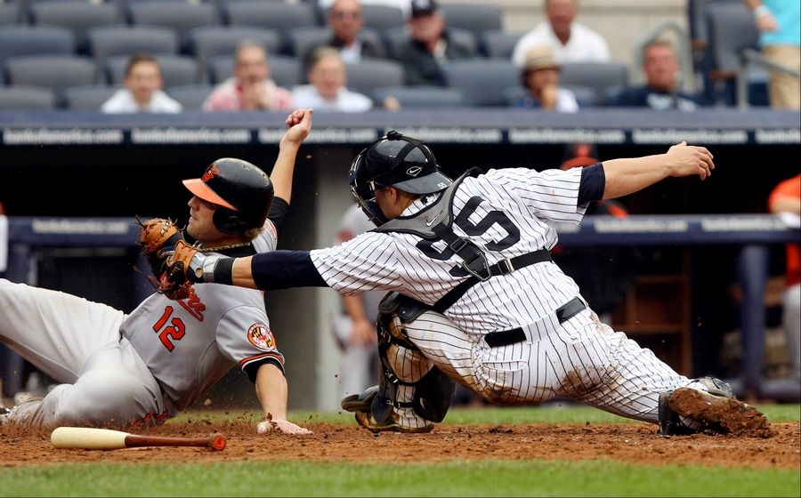 Cano hits slam, Yankees rout Orioles to stop skid