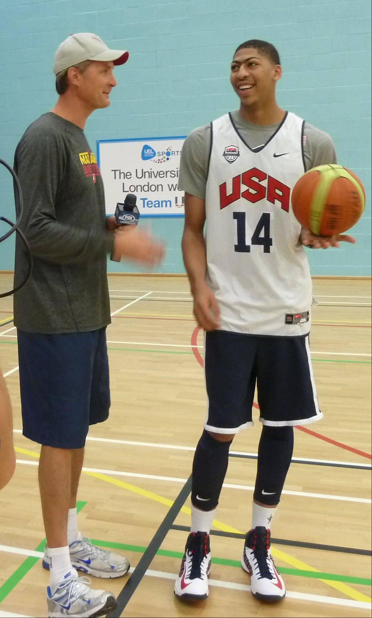 Former U.S. Olympic basketball and NBA player Christian Laettner, left, talks with current U.S. Olympic team member Anthony Davis, Monday during practice.
