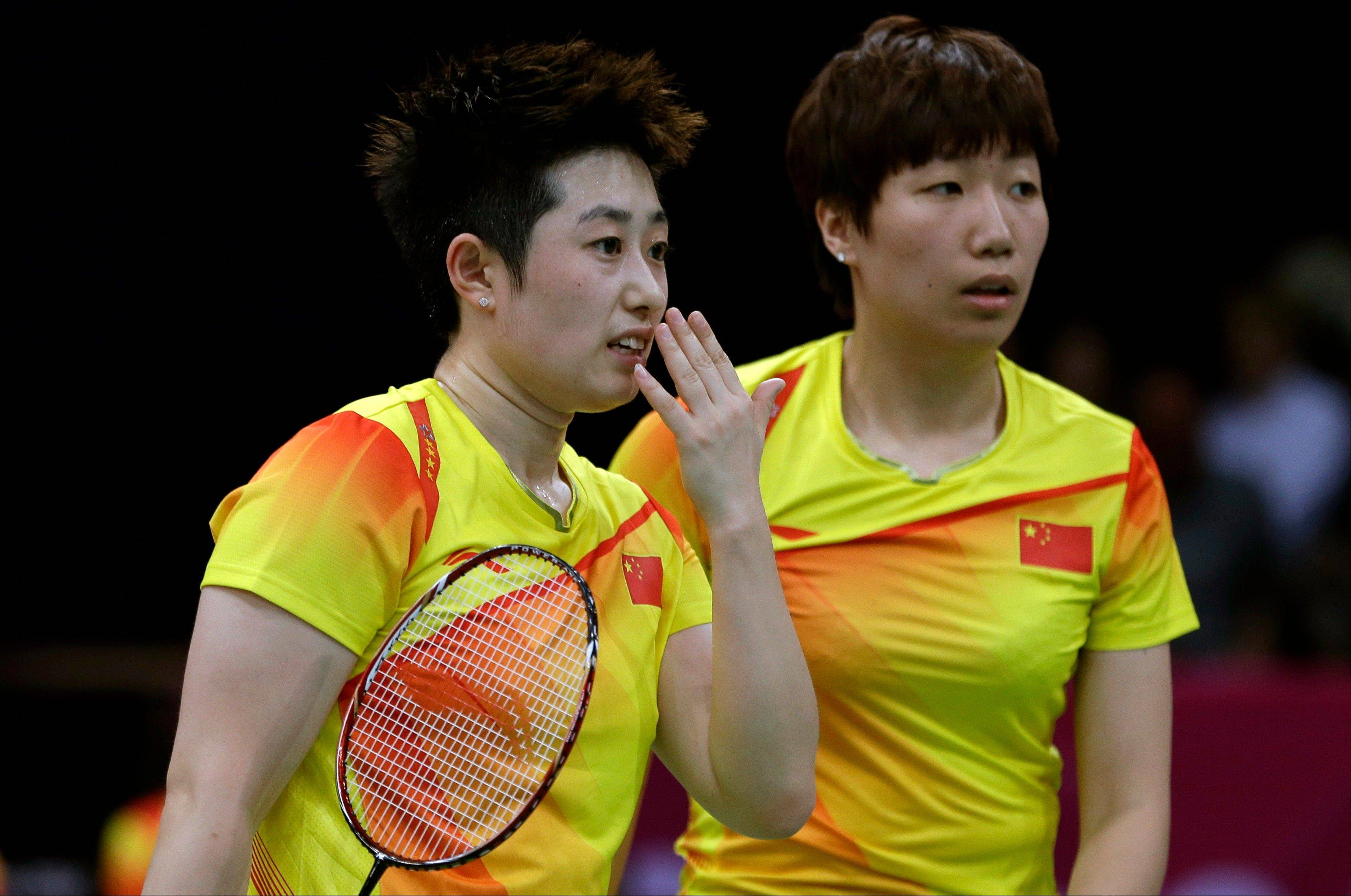 Eight female badminton doubles players, including China's Yu Yang, left, and Wang Xiaoli, were disqualified Wednesday from the London Olympics after trying to lose matches to receive a more favorable place in the tournament.