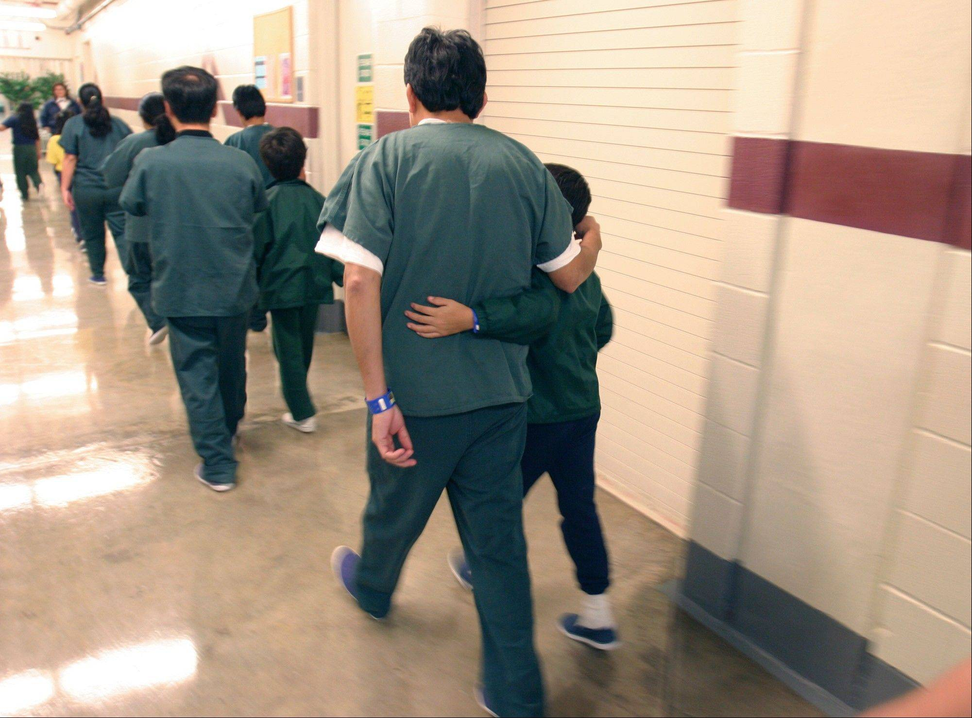 Family detainees walkg down the hall at the T. Don Hutto Residential Center in Taylor, Texas.