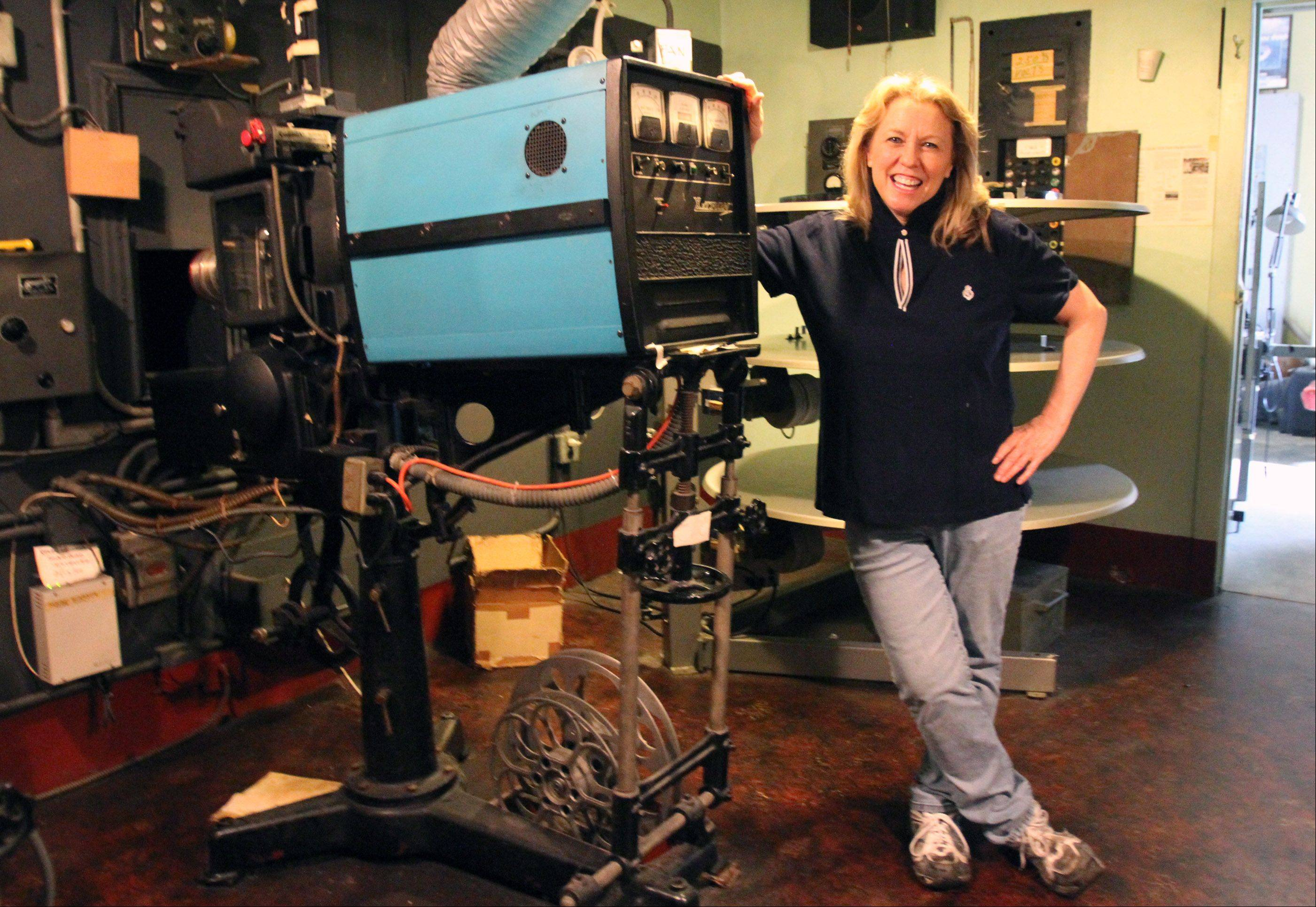 The Catlow theater co-owner Roberta Rapata in the film projection room with the 10940-50s Simplex XL film projector that is being used at the Barrington theater but doomed to be replaced by a digital machine.