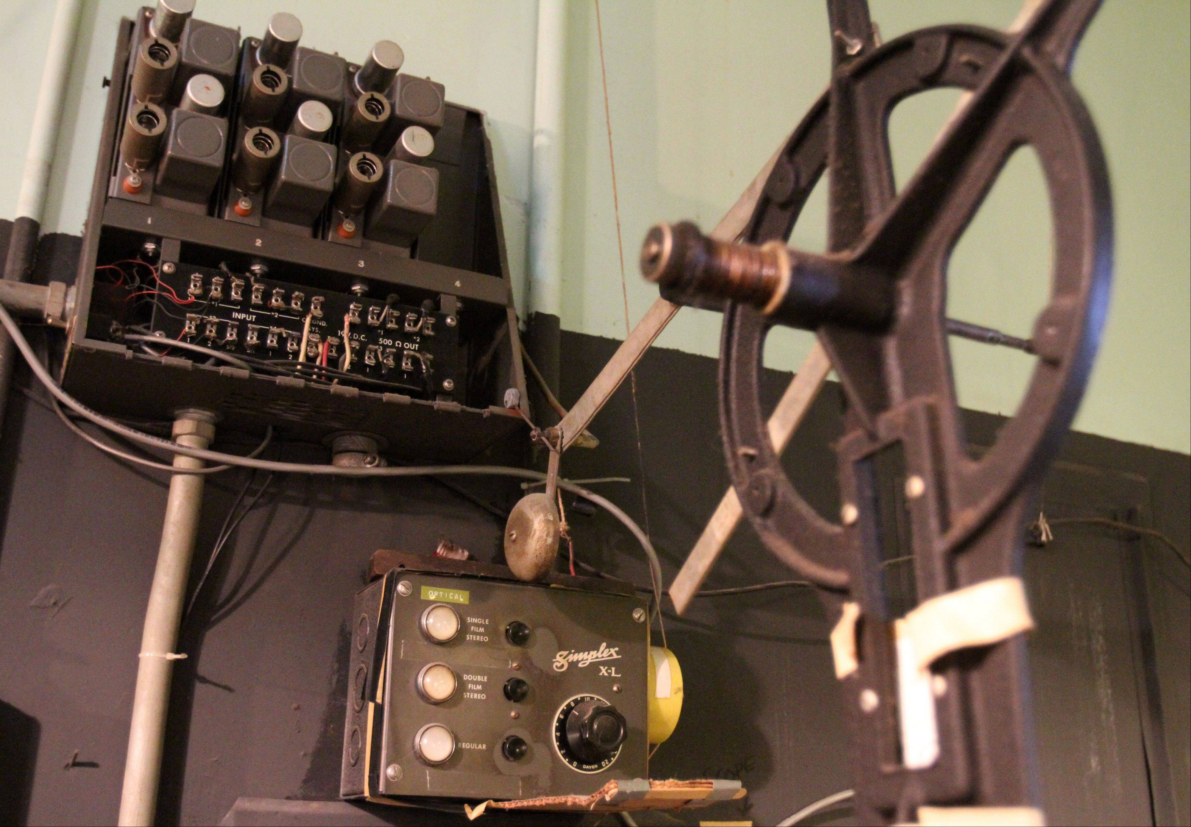 The Catlow theater's film projection room has reels and controls for the 10940-50s Simplex XL film projector on the wall that is currently being used at the theater in Barrington.
