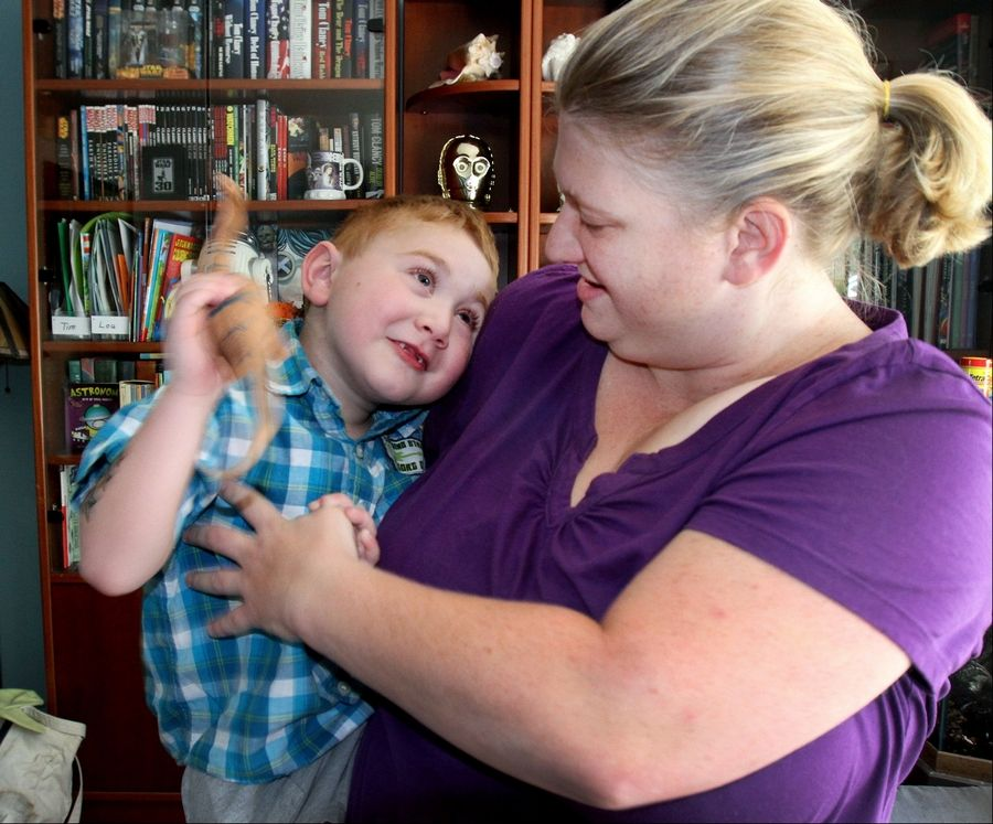 Christine Grobart of Lombard holds her 5-year-old son, Tim, who has been home for about a week after a successful heart transplant June 20.