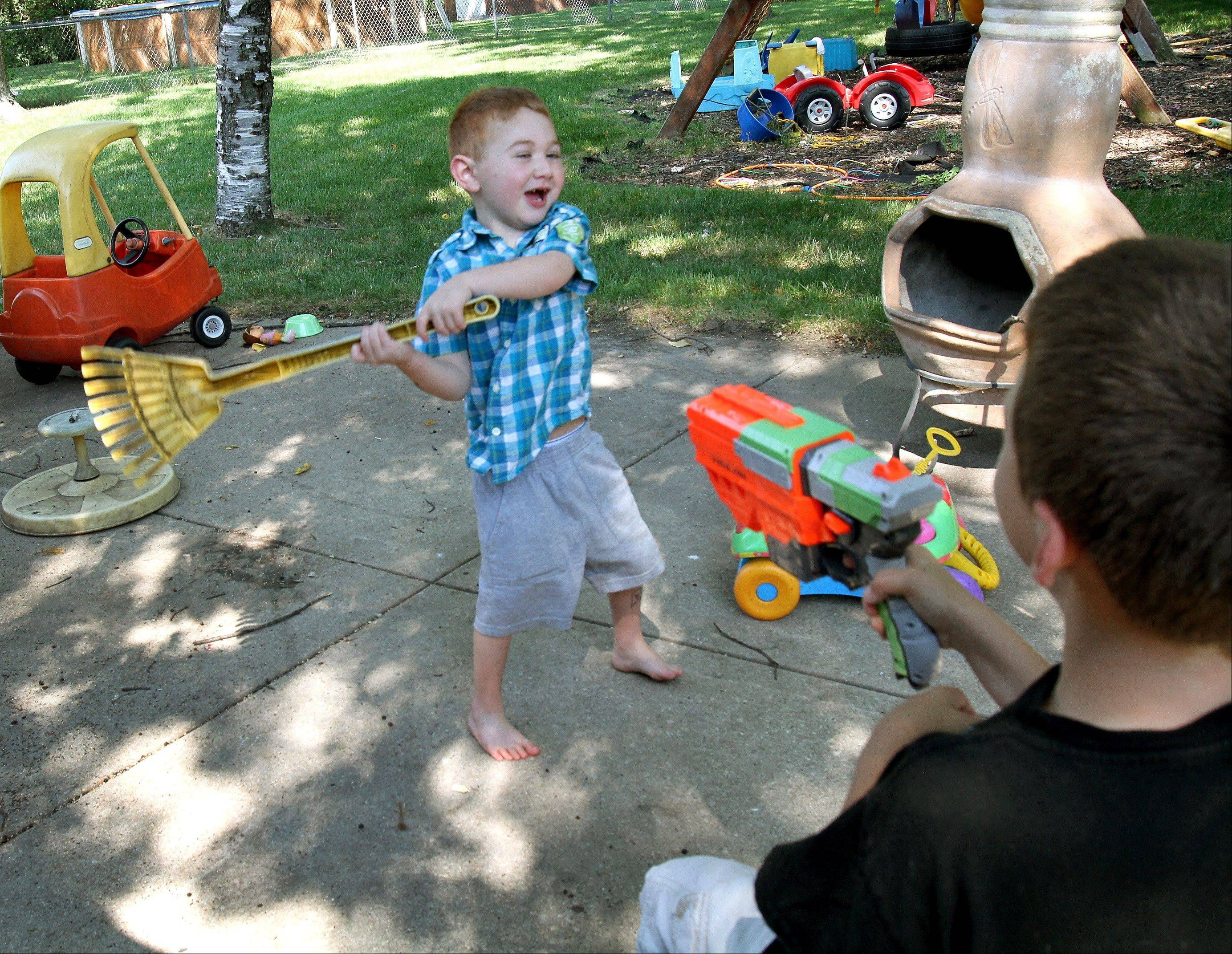 Heart transplant recipient Tim Grobart, 5, plays with his 8-year-old brother, Lou, at the family's Lombard home. Tim returned home from the hospital July 26 and has been more active than usual since receiving his new heart.