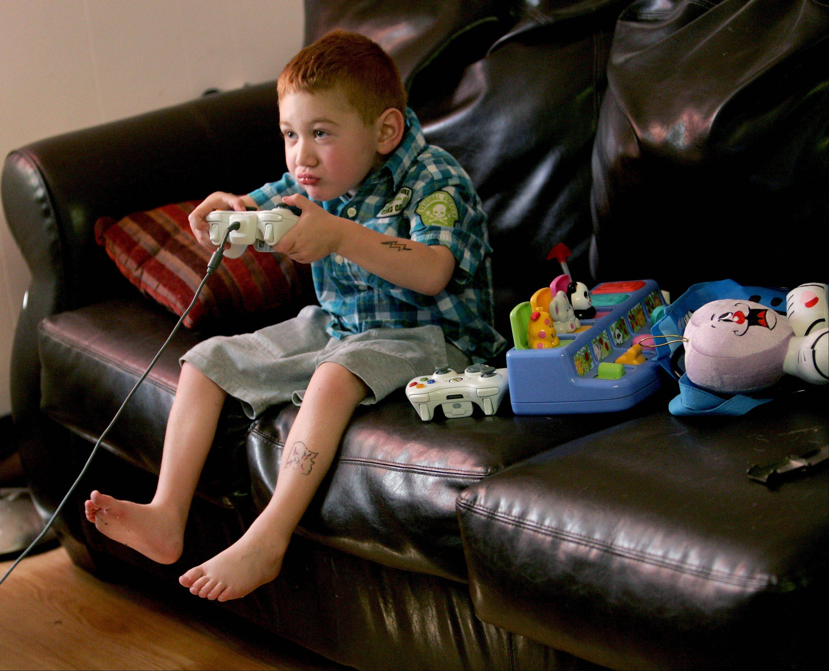 Heart transplant recipient Tim Grobart, 5, of Lombard, is now back at home and playing video games after a the successful surgery.