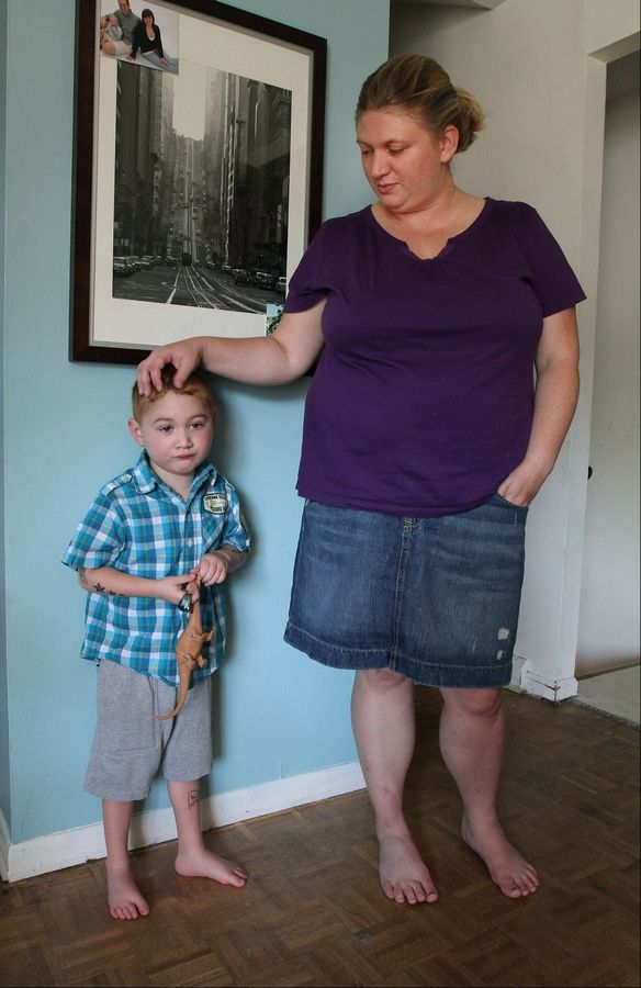 Christine Grobart is glad to have her 5-year-old son. Tim, back at the family's Lombard home.