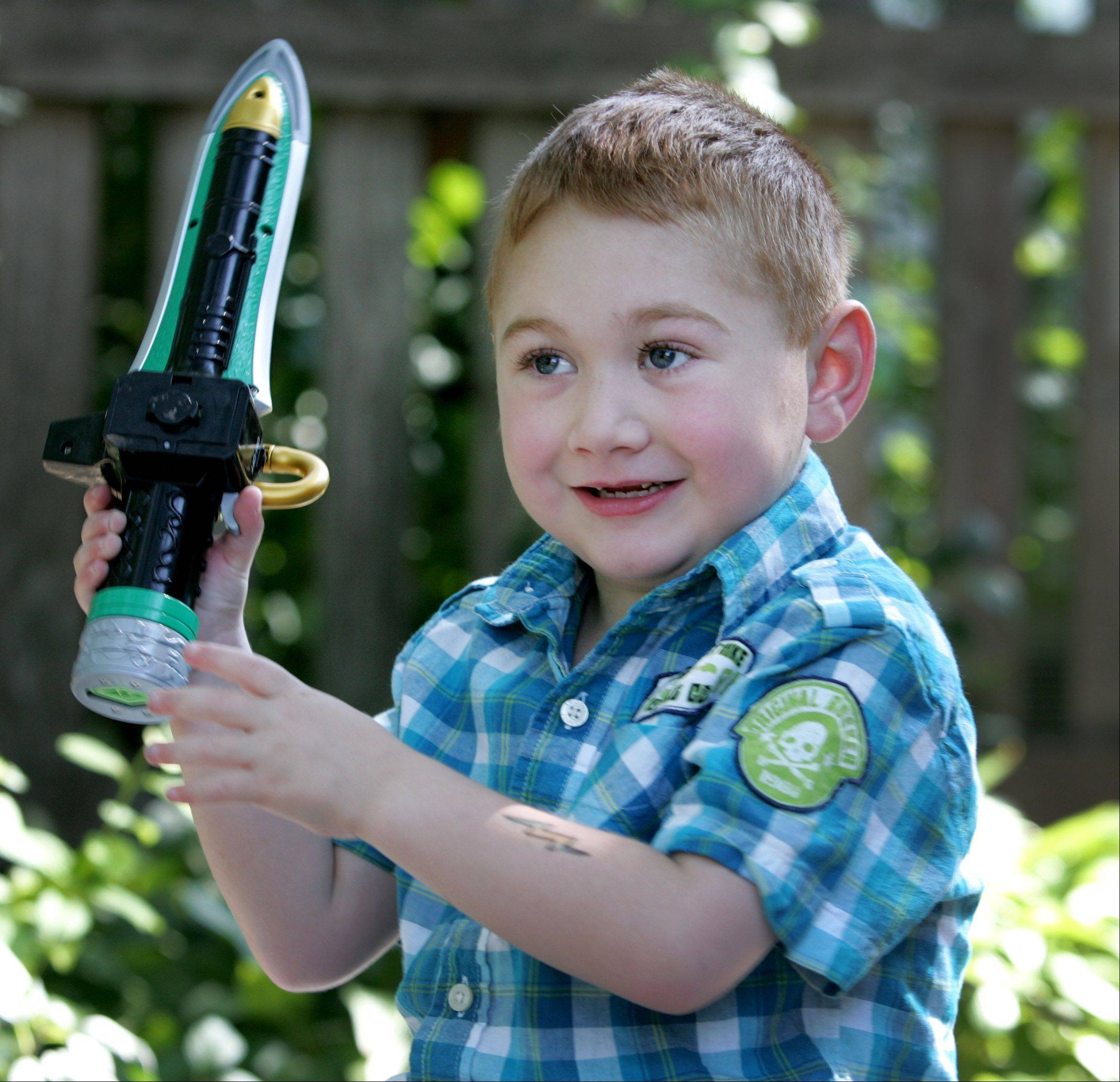 Playing with light sabers and applying temporary tattoos, like the lightning bolt on his arm, has all been part of the fun for 5-year-old heart transplant recipient Tim Grobart of Lombard since returning home from the hospital July 26.