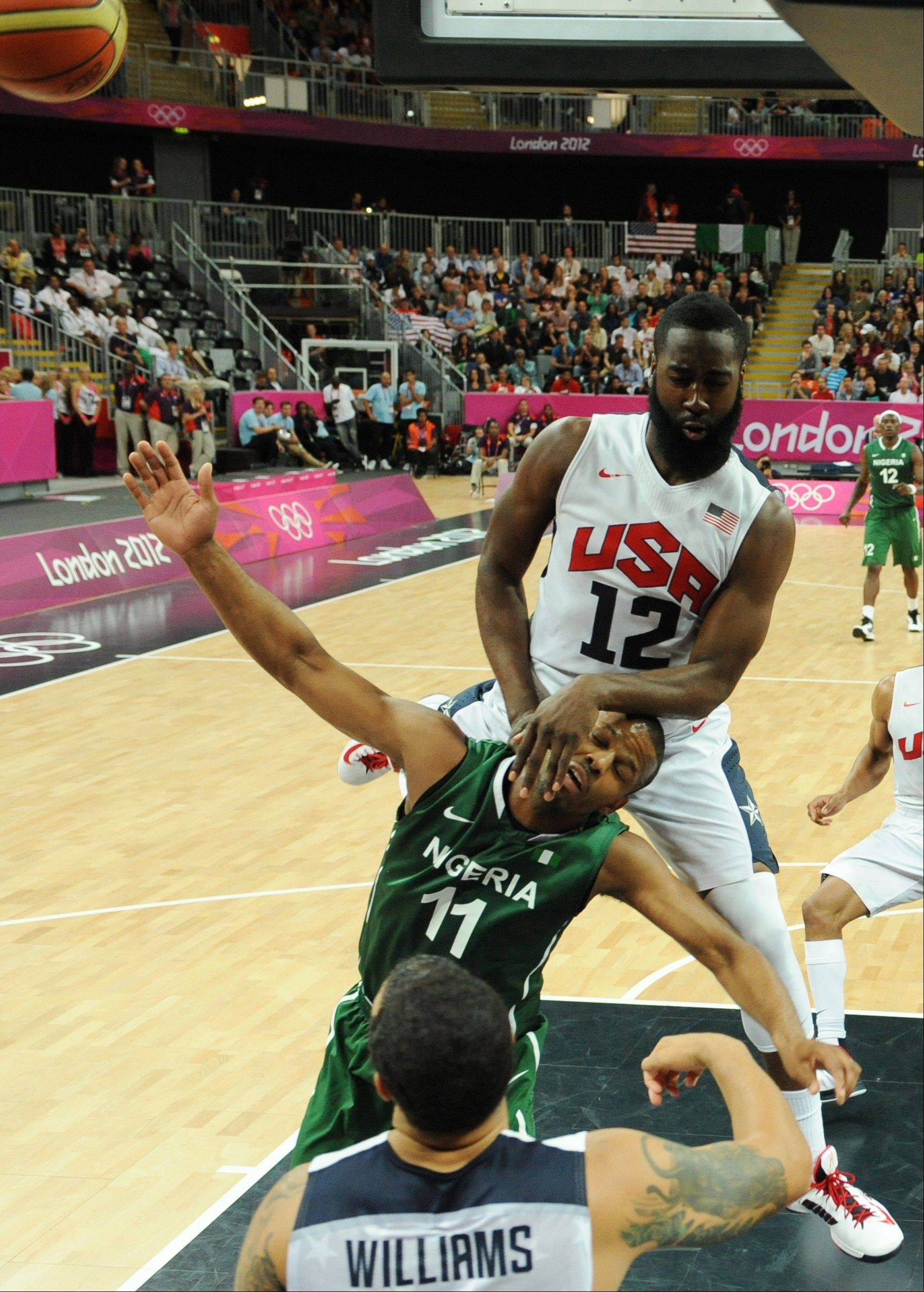 United States' guard James Harden, right, vies for the ball with Nigerian guard Richard Oruche during their men's preliminary round basketball match at the 2012 Summer Olympics.