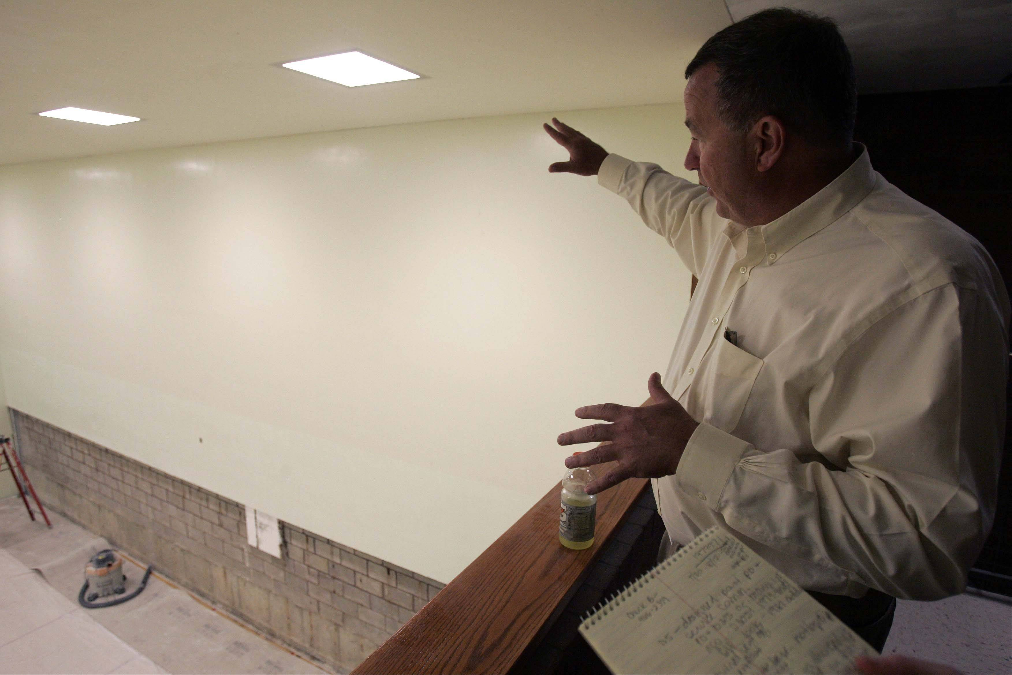 St. Charles School District 303 Superintendent Don Schlomann describes Thursday how and where mold was discovered during scheduled maintenance this summer at the Norris Recreation Center. The mold was discovered in the north wall of racquetball court 3, which was part of an addition in 1981 to the original 1974 building. The rec center is connected to St. Charles East High School, which was the site of a major mold problem in 2001.