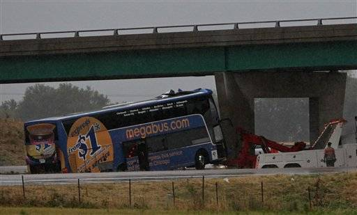 The Megabus is pulled away from the bridge support Thursday evening Aug. 2, 2012 on southbound Interstate 55 north of Litchfield, Ill. The packed double-decker Megabus slammed into an Illinois interstate bridge support pillar Thursday, hurtling screaming passengers from their seats and leaving at least one person dead and more than three dozen injured, officials said.