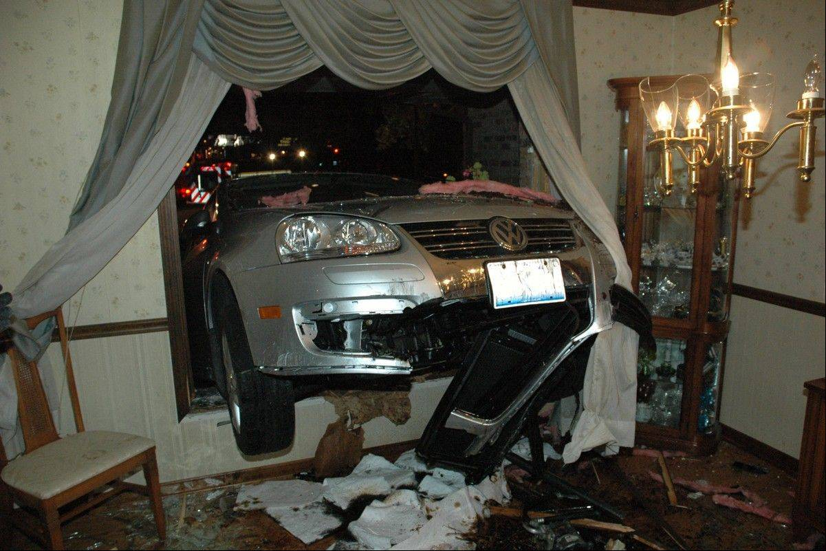 No one was injured late Monday when 17-year-old Joseph Wheeler drove this car through the dining room window of a Naperville home.