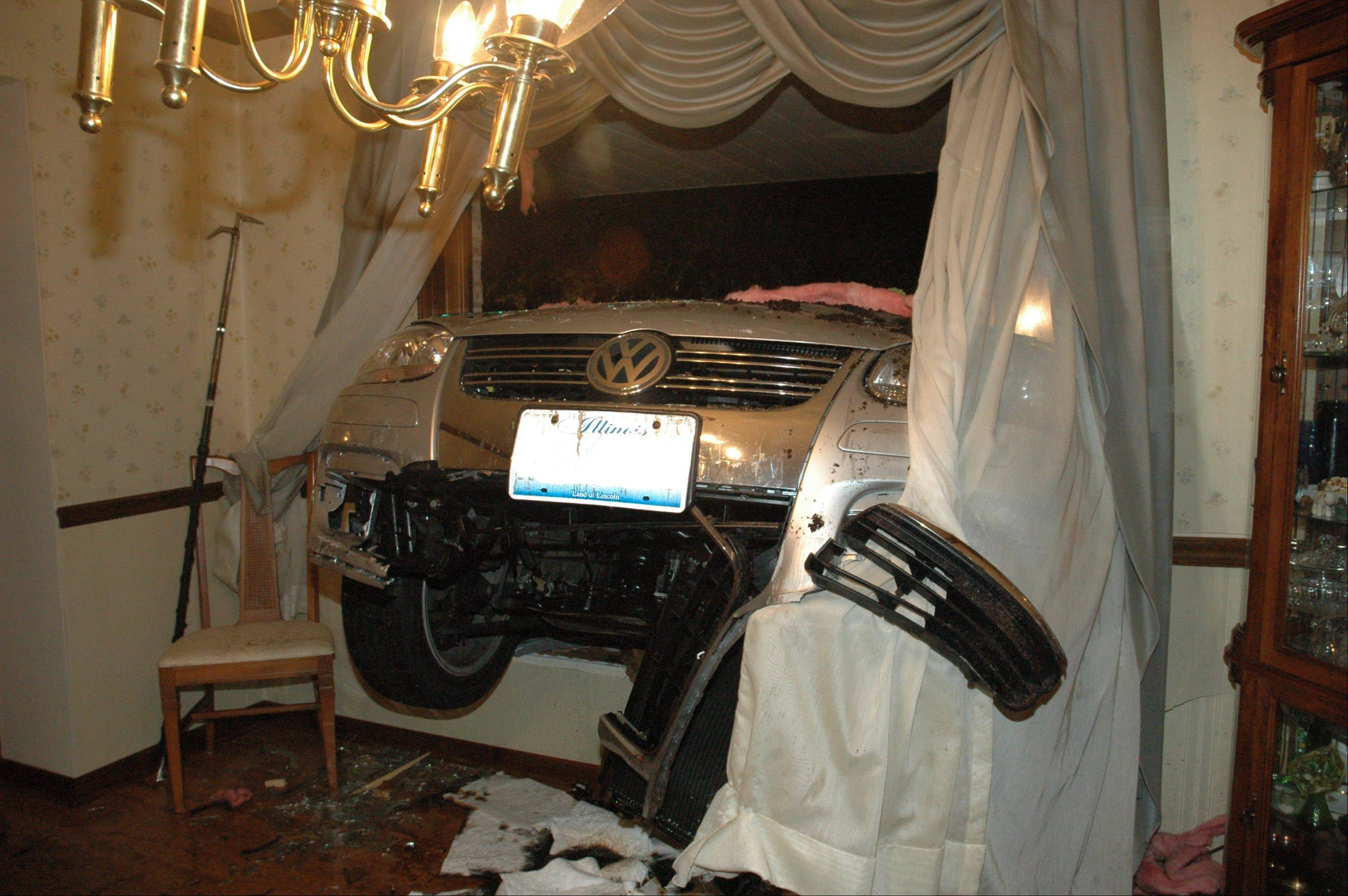 Residents were home but uninjured late Monday when a car driven by an intoxicated teenager drove into their dining room.