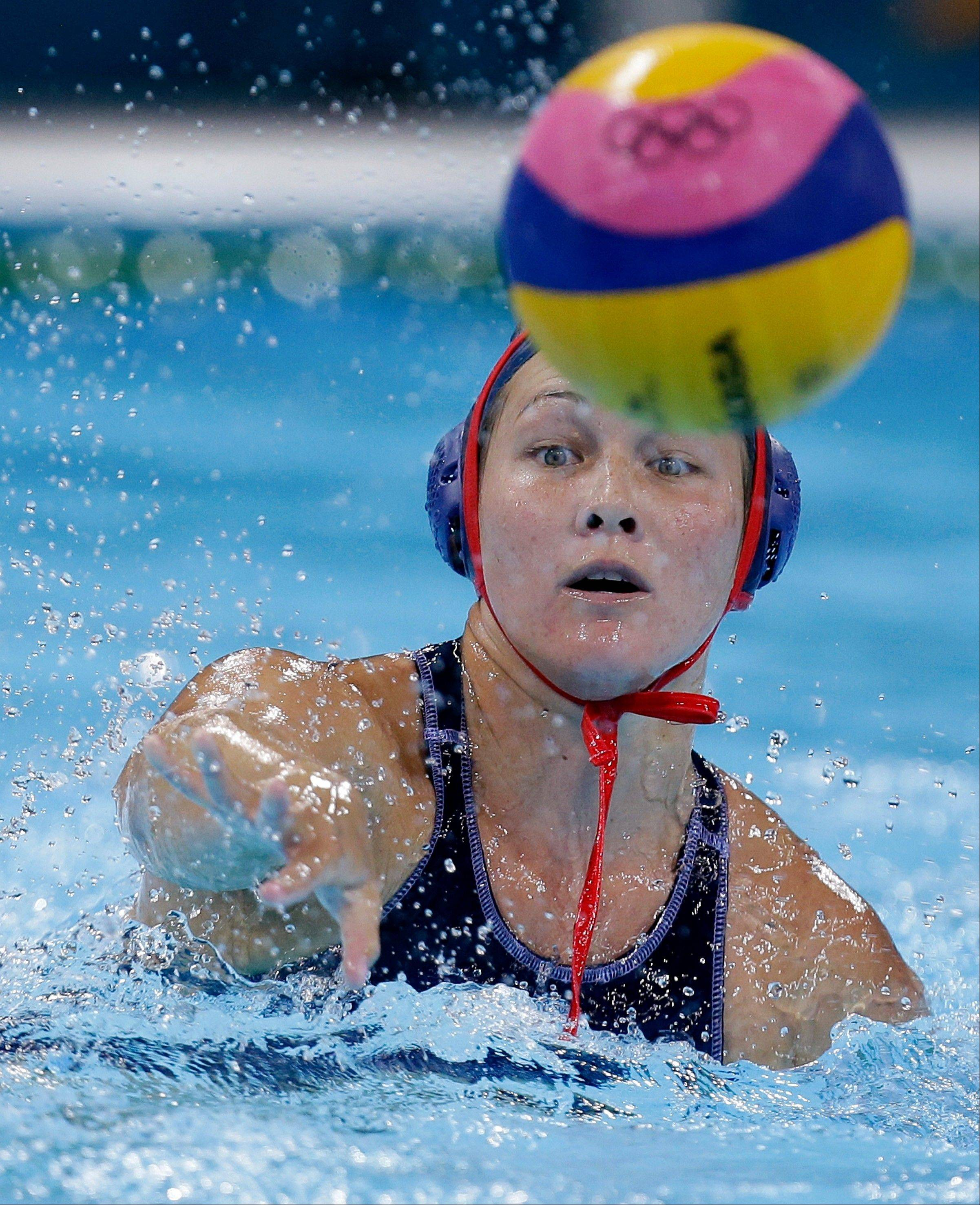 Melissa Seidemann of the United States shoots at goal during their women's water polo preliminary round match against Spain Wednesday at the 2012 Summer Olympics. She tallied 1 score in the 9-9 match.
