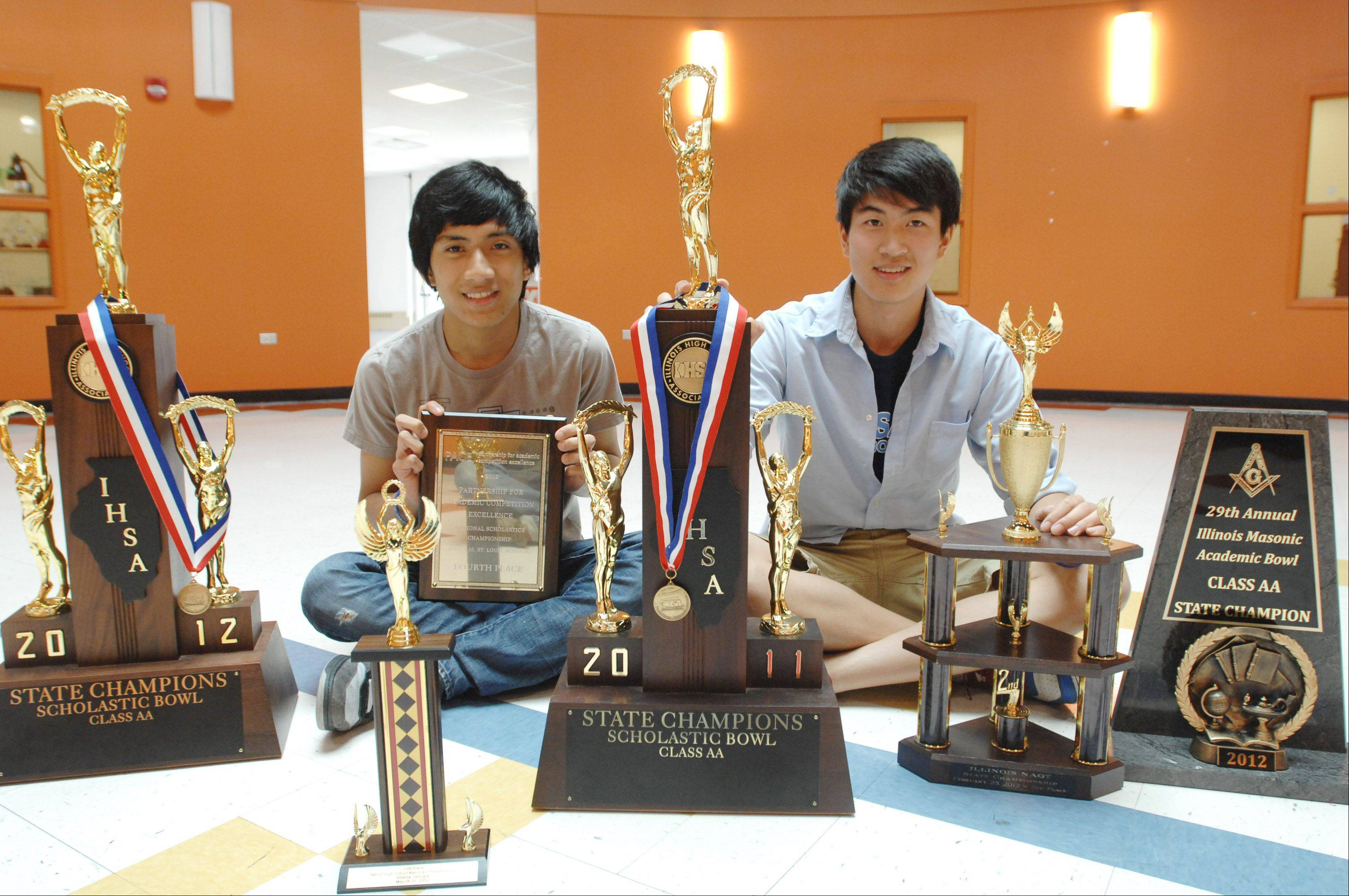 Eric Ordoñez of Aurora, left, and Webster Guan of Lisle, recent graduates of the Illinois Mathematics and Science Academy in Aurora, were co-captains of the school's quiz bowl team, which won the state championship in 2011 and 2012 and placed fourth at a national competition in June.