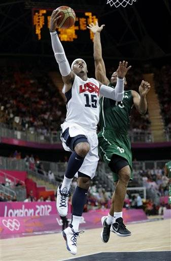 USA's Carmelo Anthony drives to the basket past Nigeria's Derrick Obasohan. Anthony finished with 38 as the U.S. men routed Nigeria 156-73.