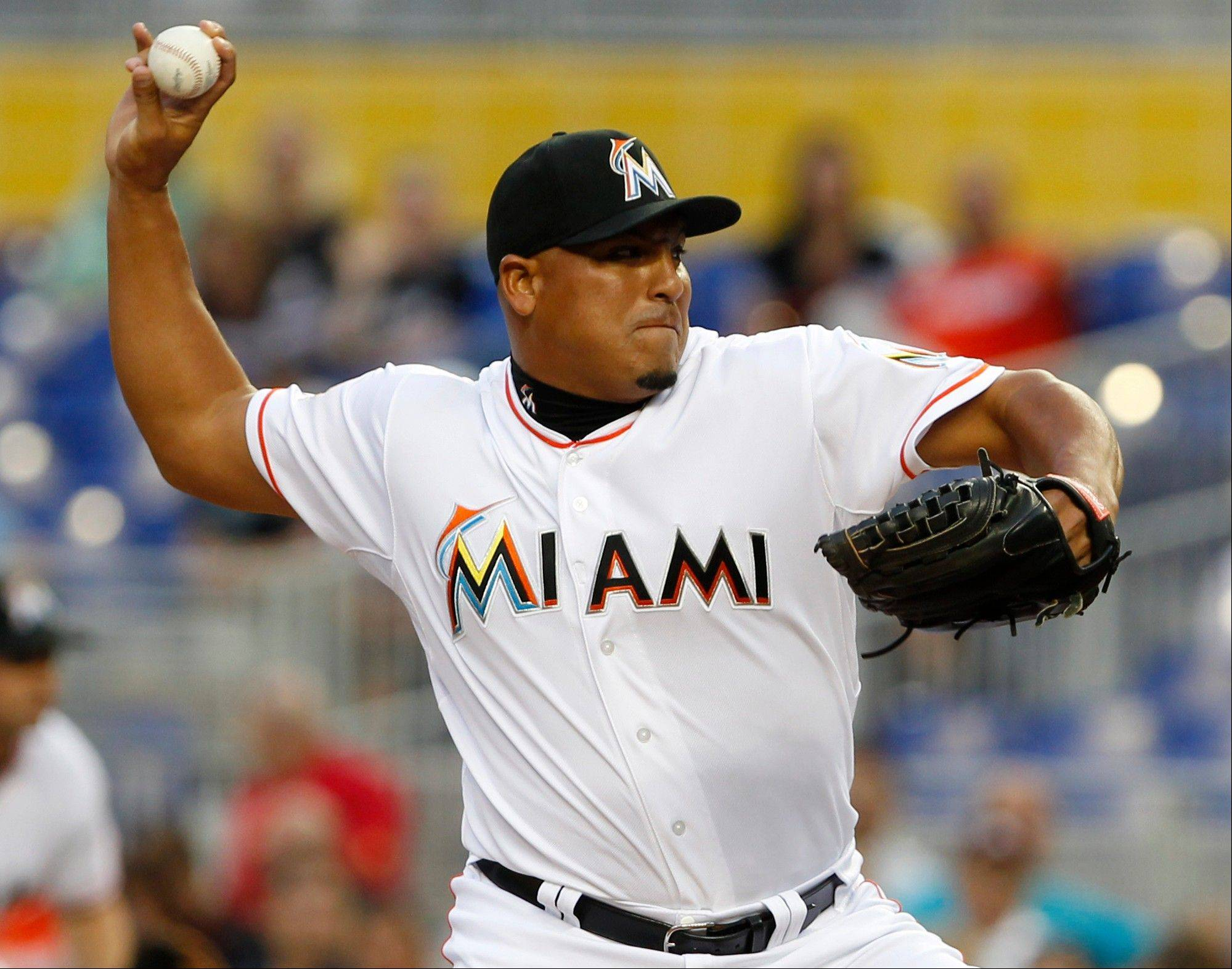 Miami Marlins' Carlos Zambrano delivers a pitch during the first inning of a baseball game against the Houston Astros, Saturday, April 14, 2012, in Miami.