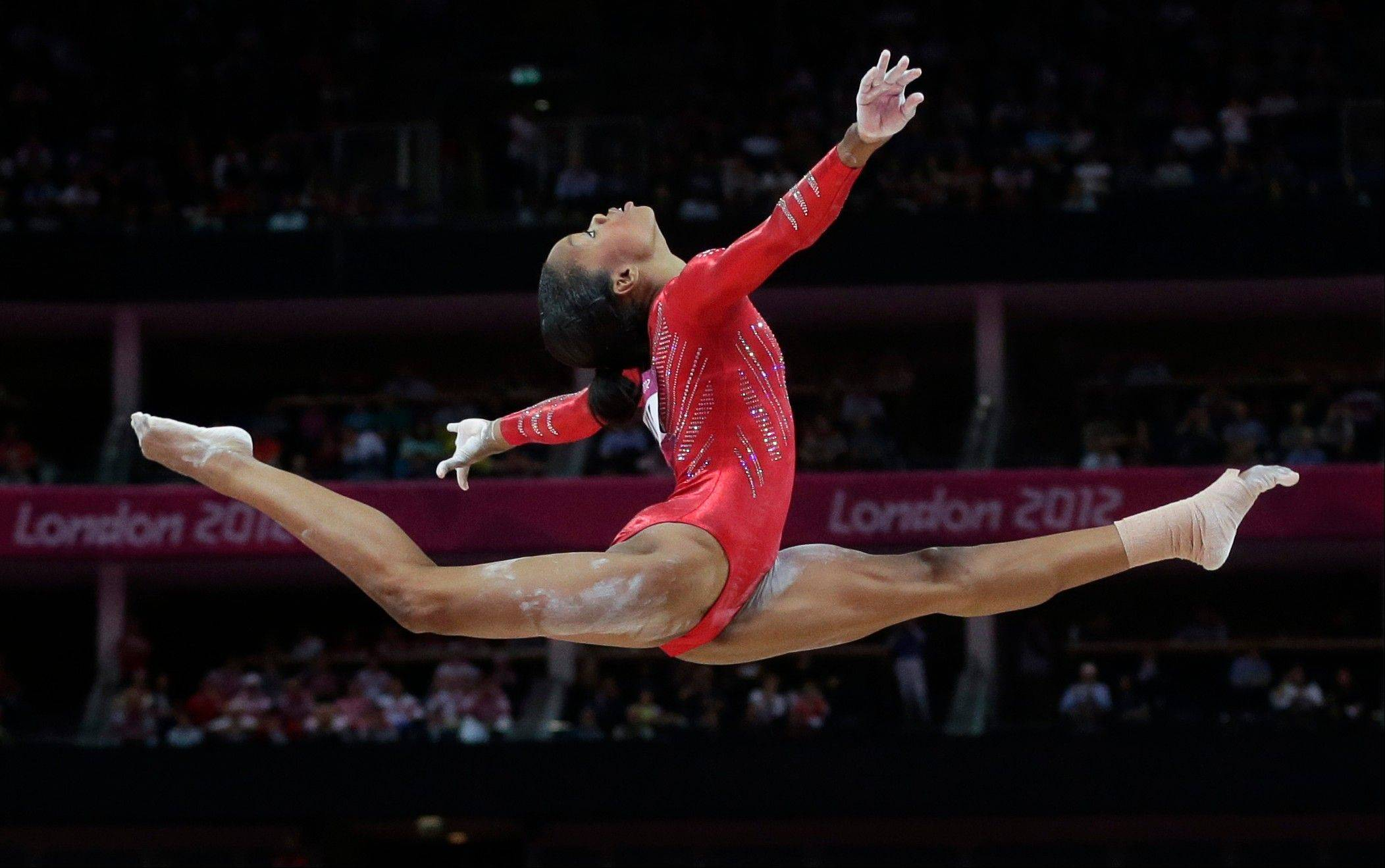 U.S. gymnast Gabrielle Douglas performs on the balance beam during the Artistic Gymnastics women's team final at the 2012 Summer Olympics,