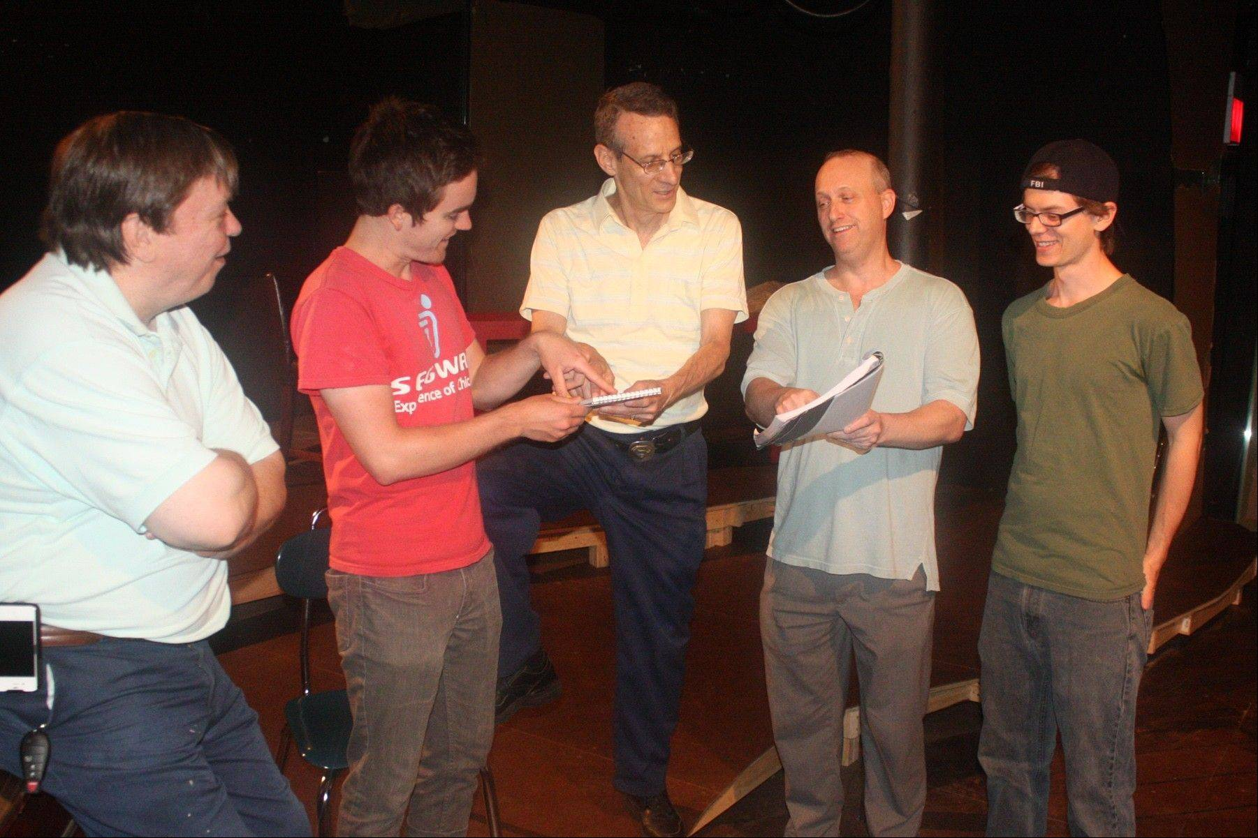 "Playwright David Alex, center, works with the cast for ""Adrift,"" presented by Polarity Ensemble Theatre at the The Greenhouse Theater Center in Chicago."